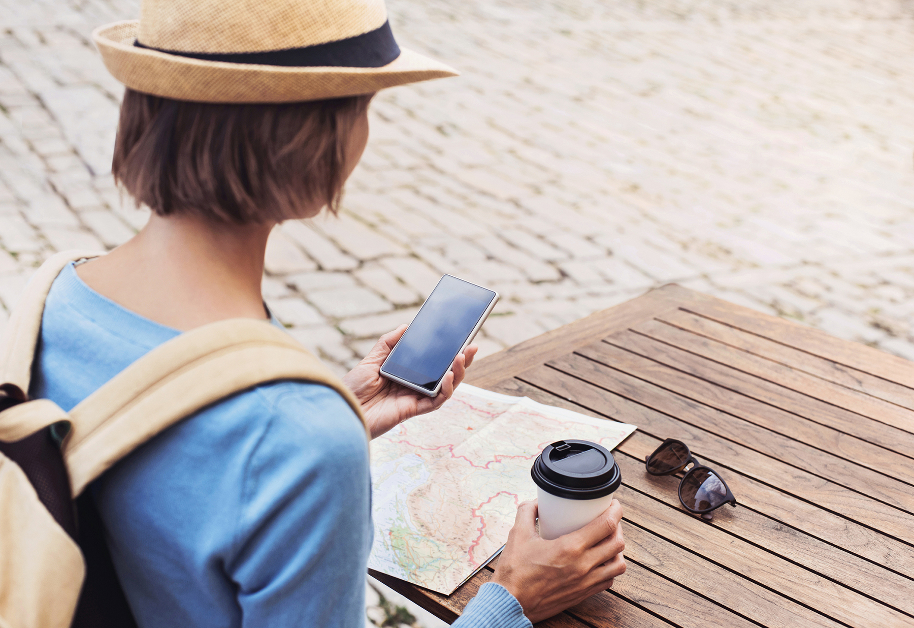 Traveling woman looking at phone