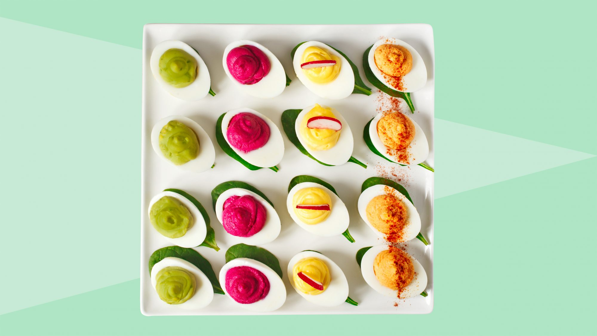 4 types of deviled eggs on a platter