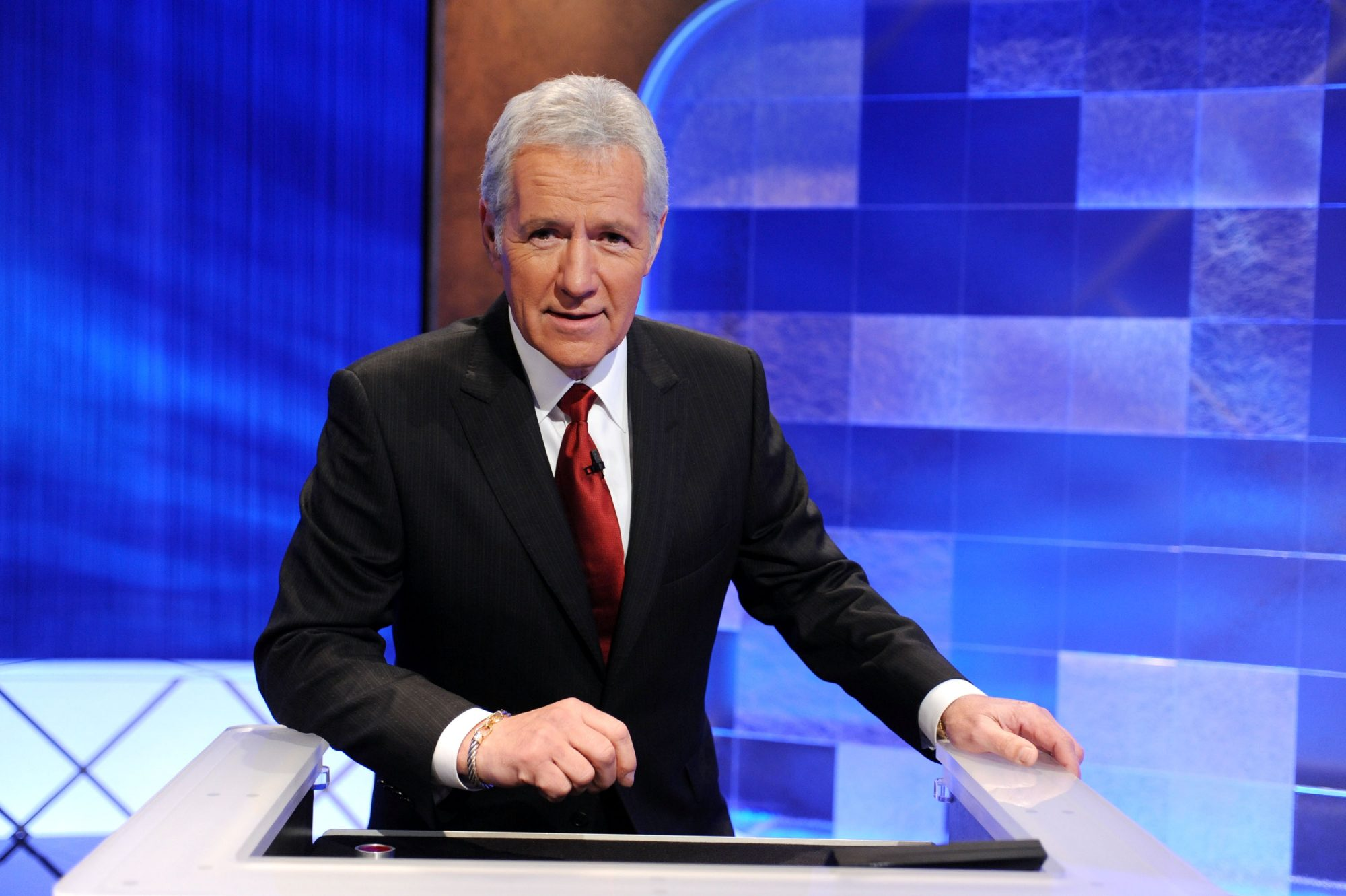 Alex Trebek at Jeopardy podium