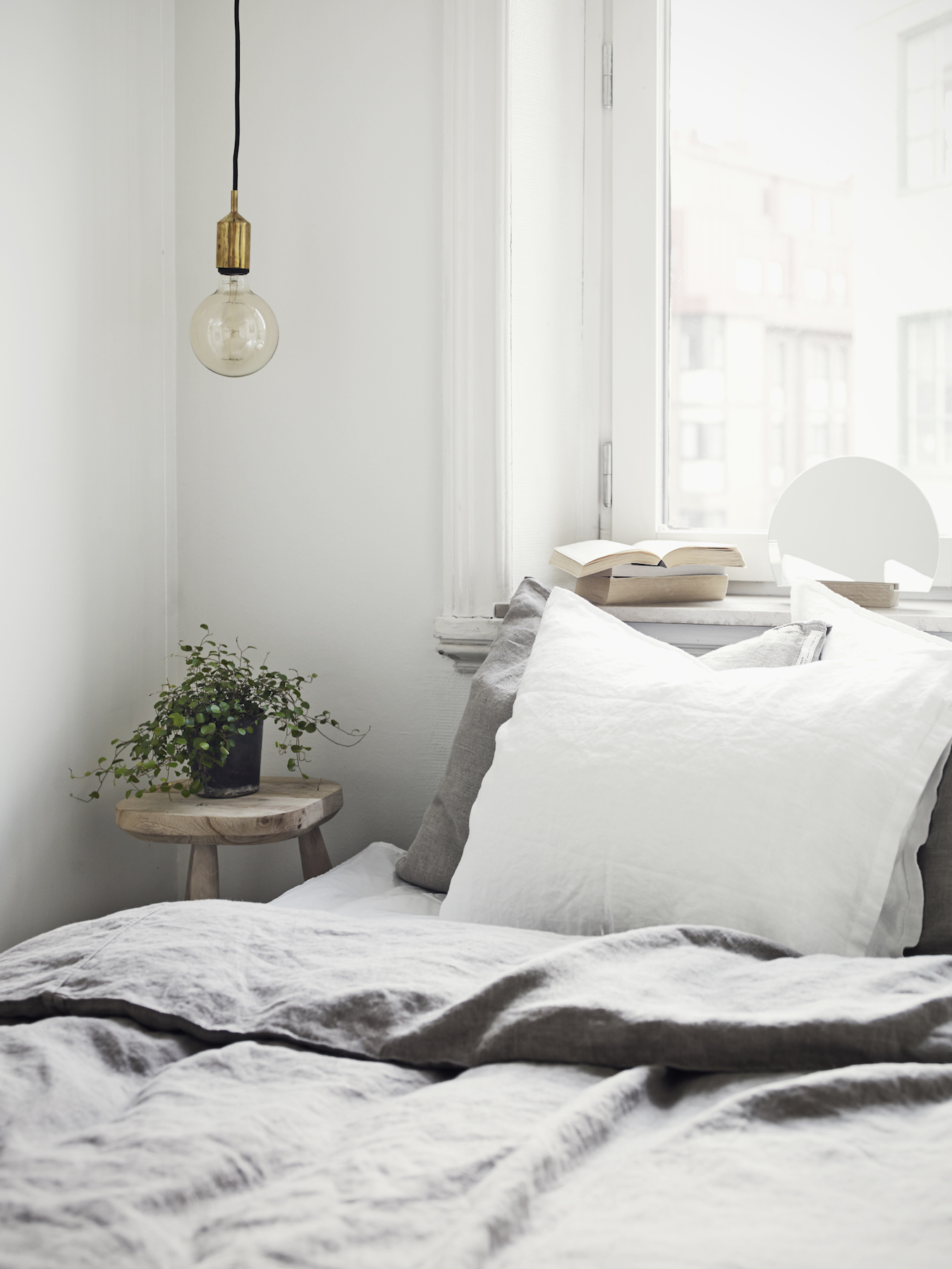 Bed with Gray Pillows