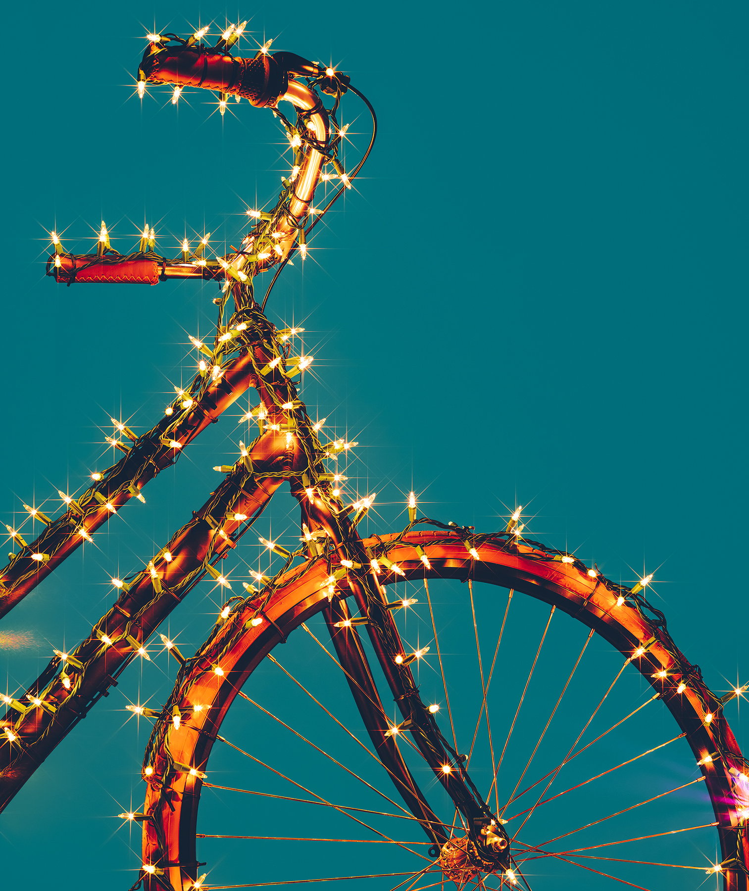 Bicycle wrapped in lights