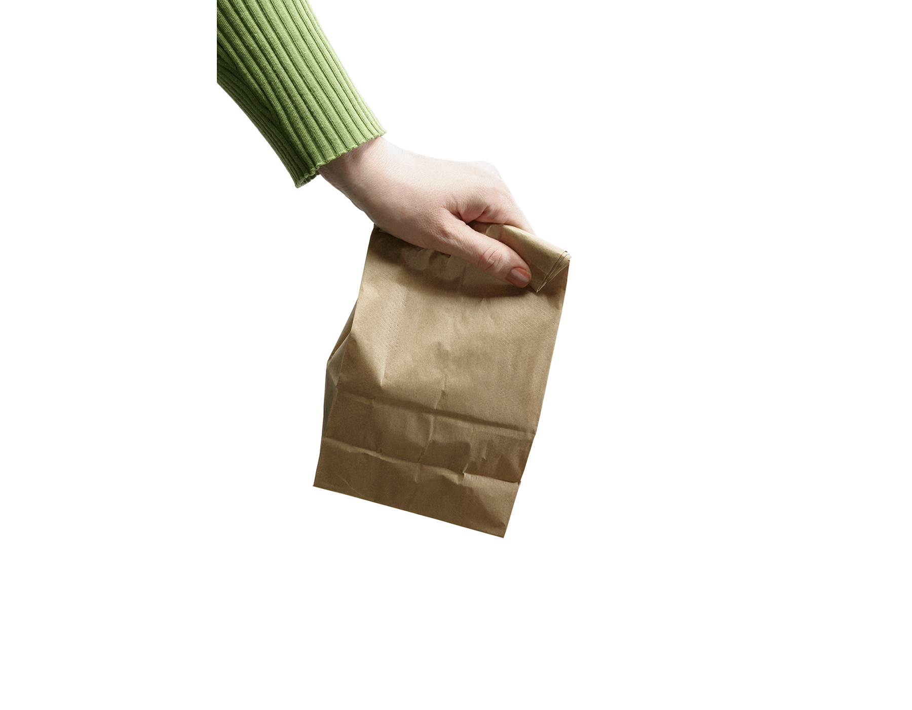 Hand with brown bag lunch