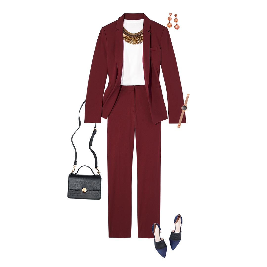 Professional burgundy suit with flats watch and satchel