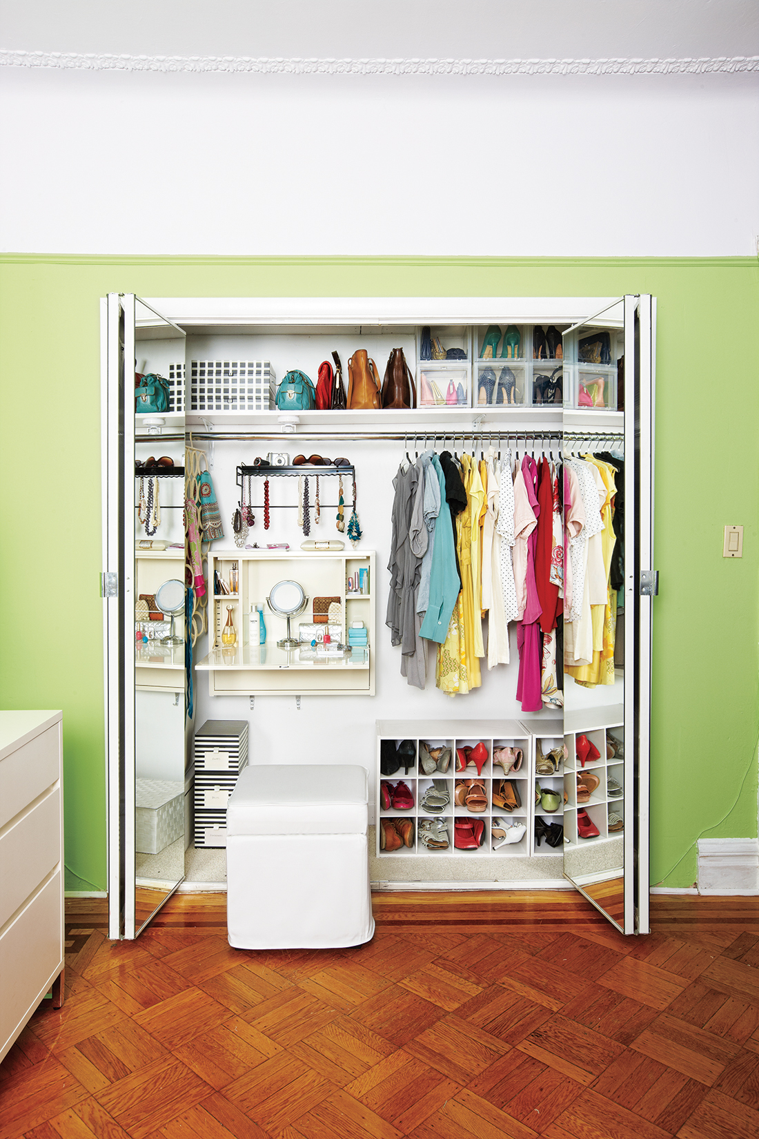 Organized closet in green room