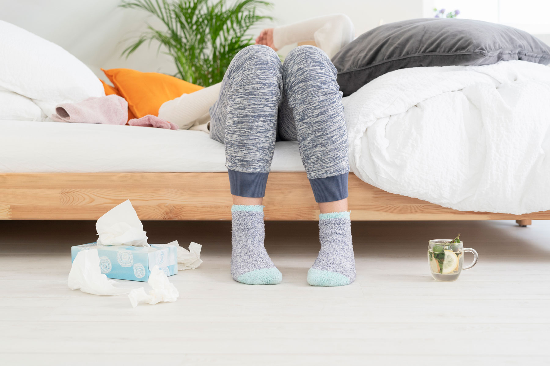 Cold and Flu Prevention Surprising Tips - Sick woman with tissues