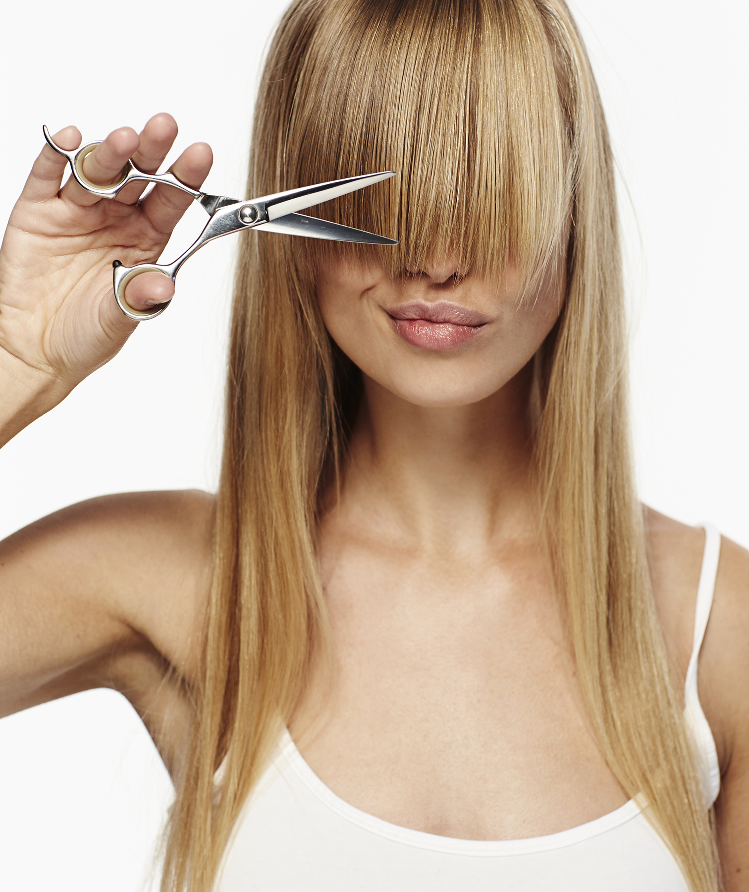 Model about to cut her own bangs