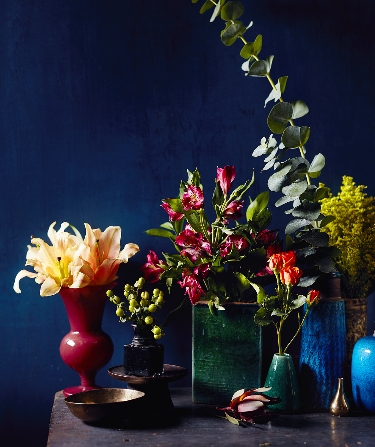 Deconstructed flower bouquets in multiple vases