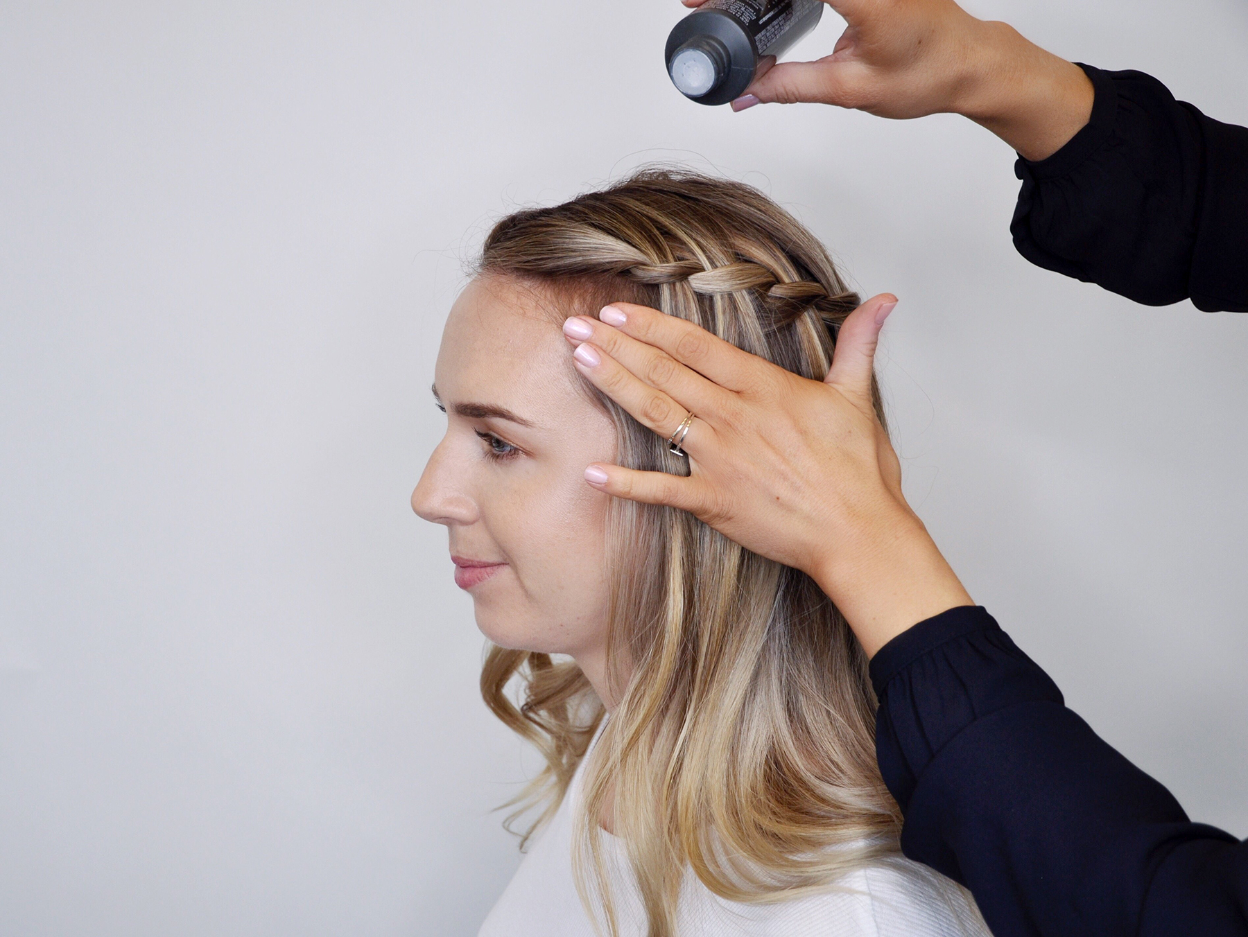 Applying texture powder to waterfall braid