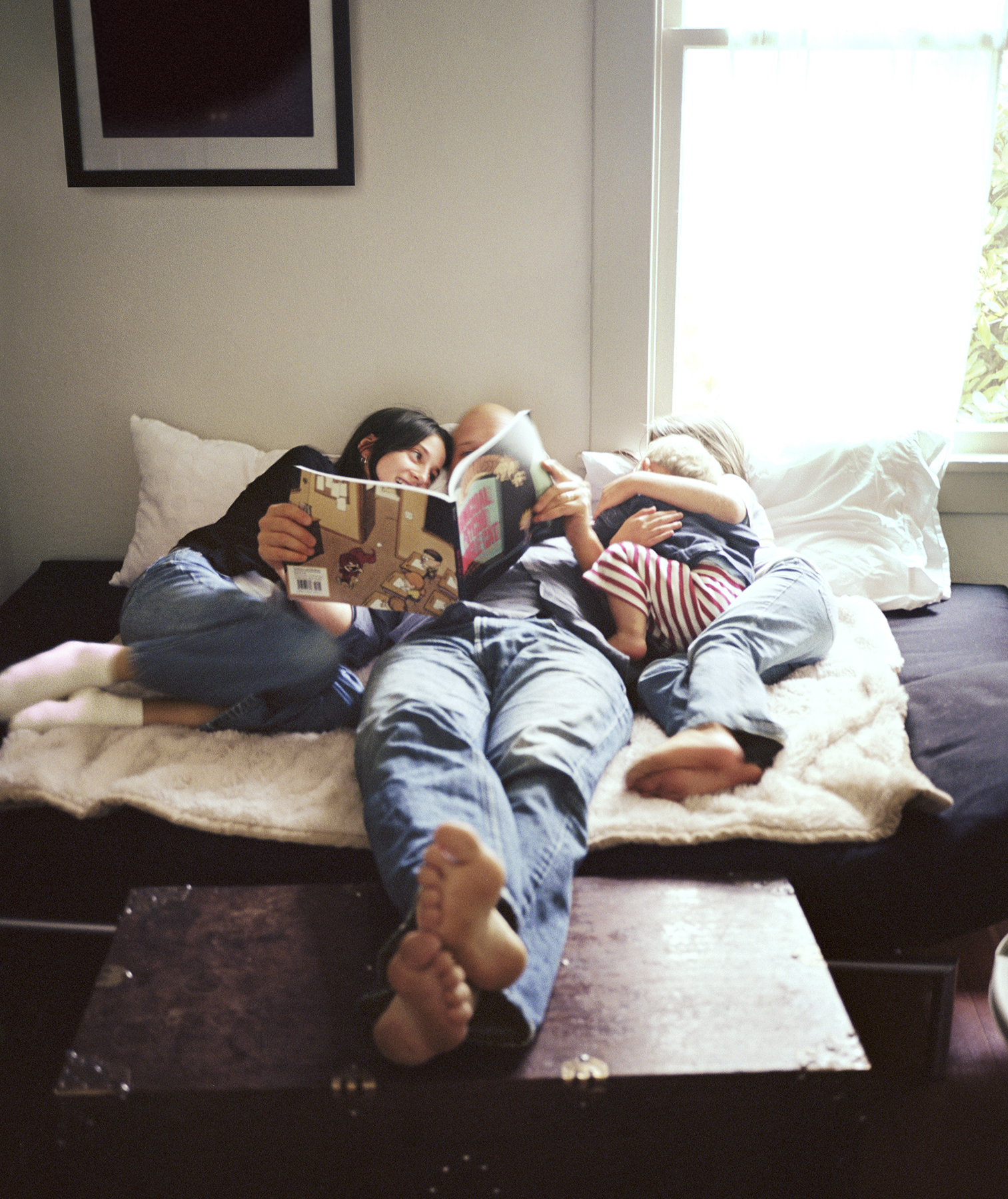 Family reading together in bed