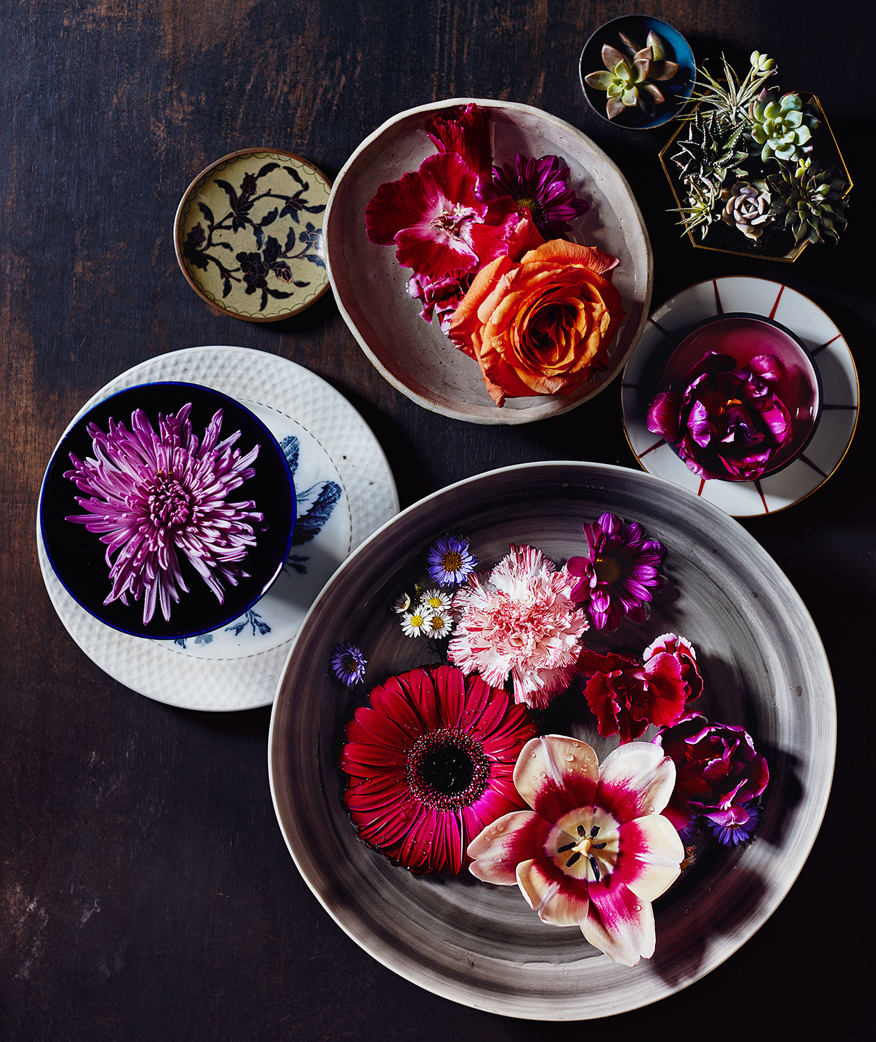 Flowers floating in bowls