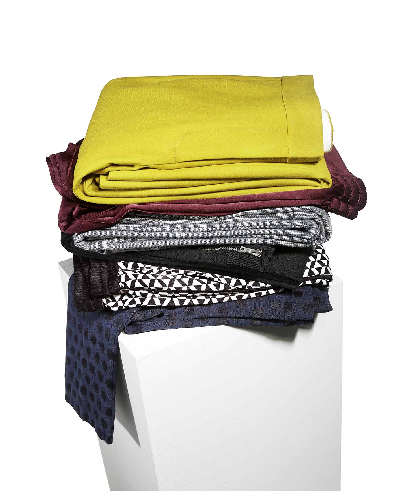 Stack of folded pants on pedestal