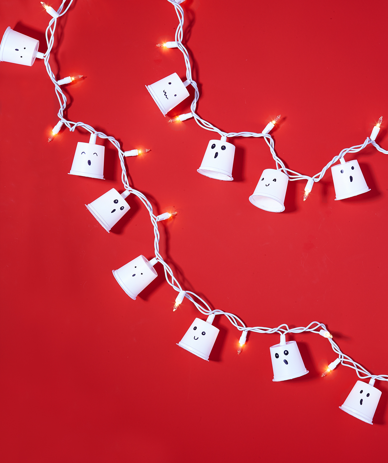 Coffee K-cups + Holiday Lights = Ghostly Garland