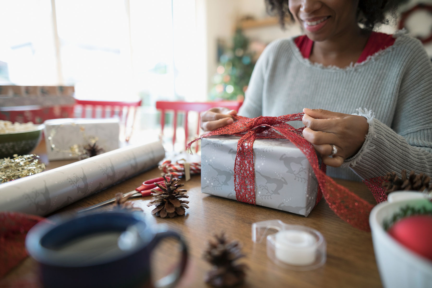 Woman wrapping gifts - gift wrapping mistakes