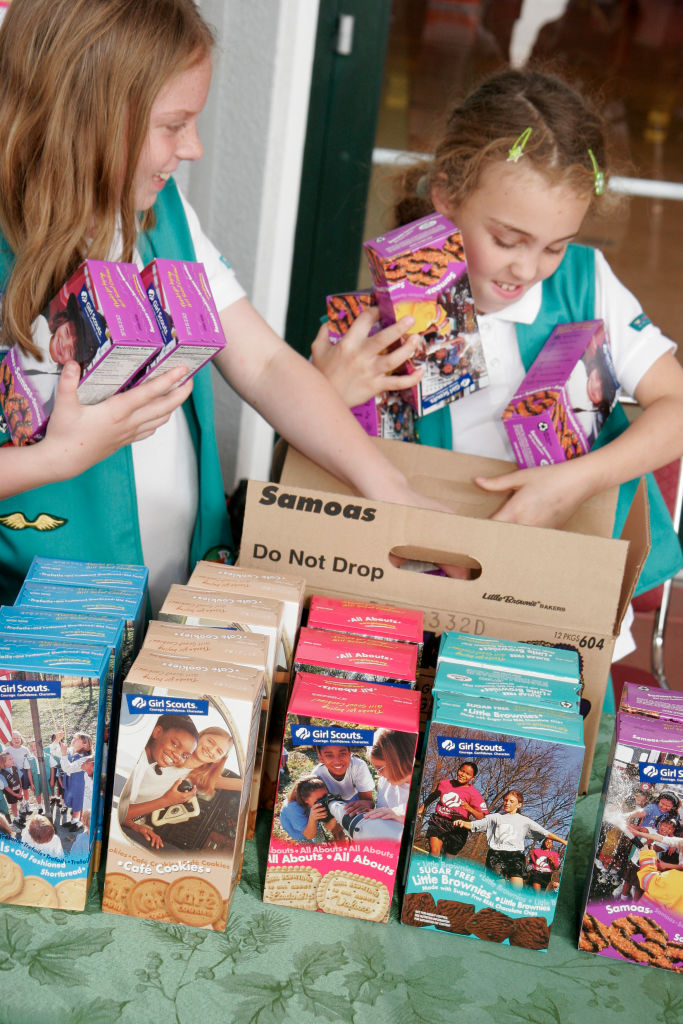 Girl Scouts packing cookies