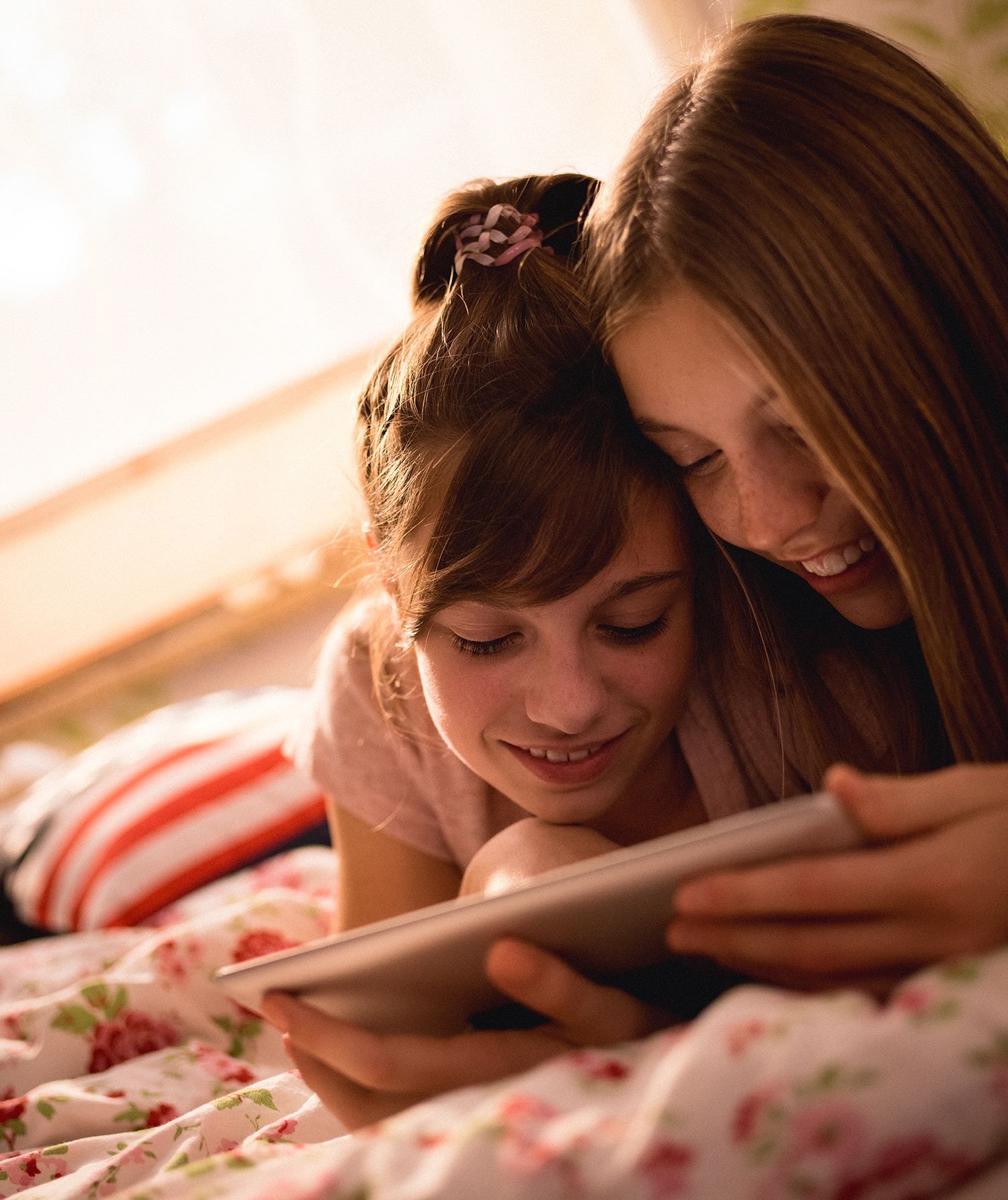 2 girls looking at tablet