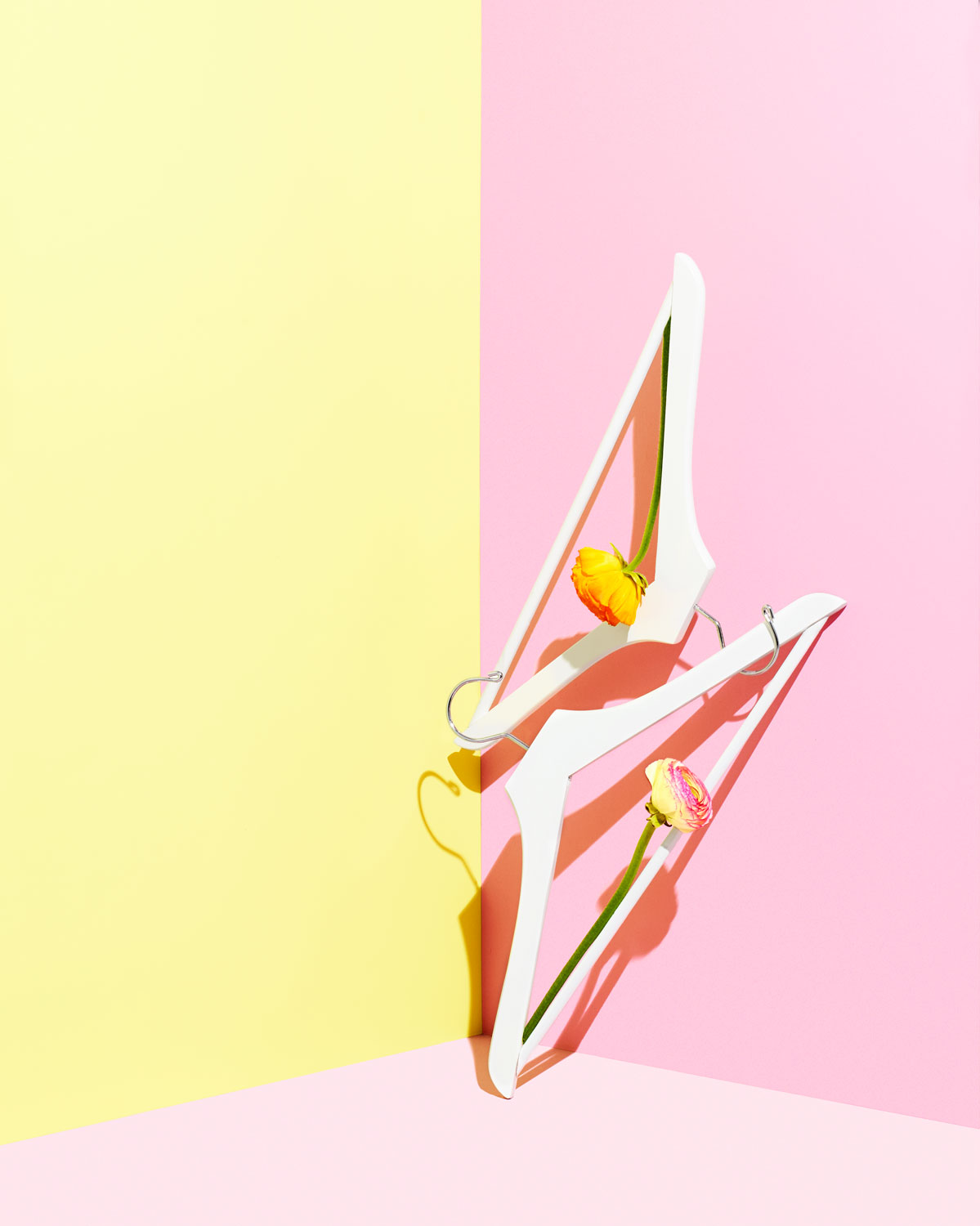 Hangers on pink and yellow background