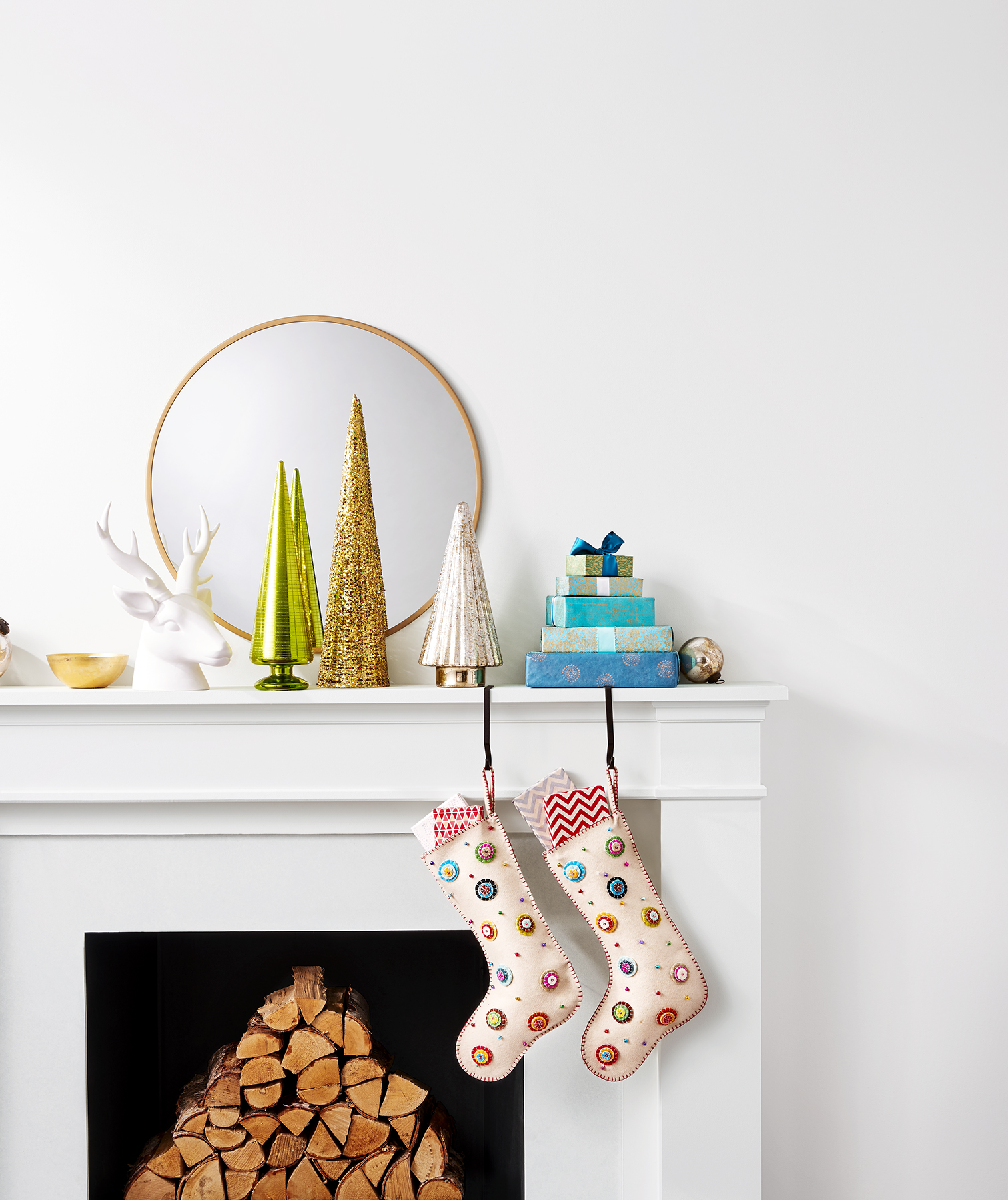 Holiday mantel with bright colored decorations and stockings