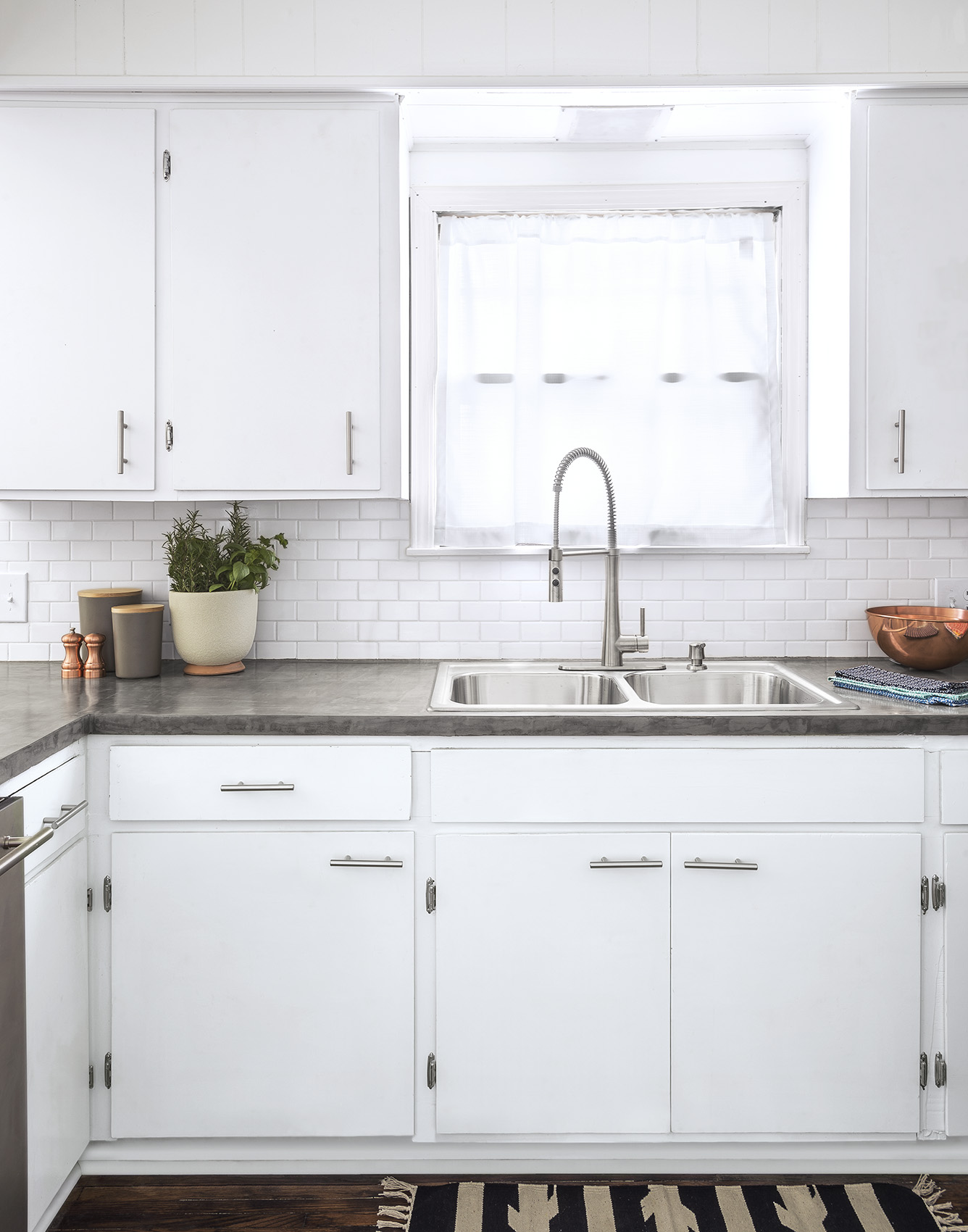 Kitchen with white cabinets and white tile
