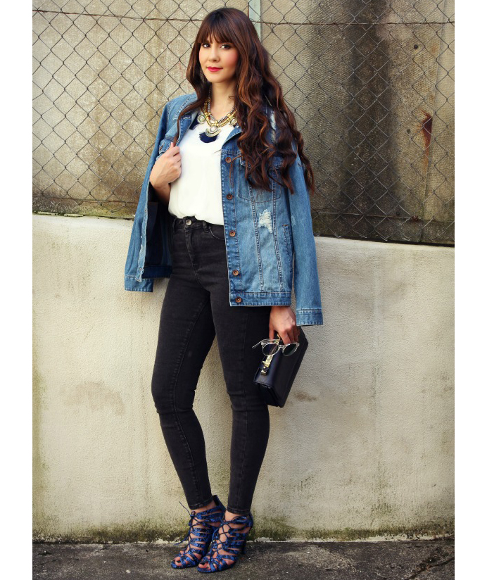 63baa308670 Woman wearing hip-length denim jacket with black jeans and cage heels