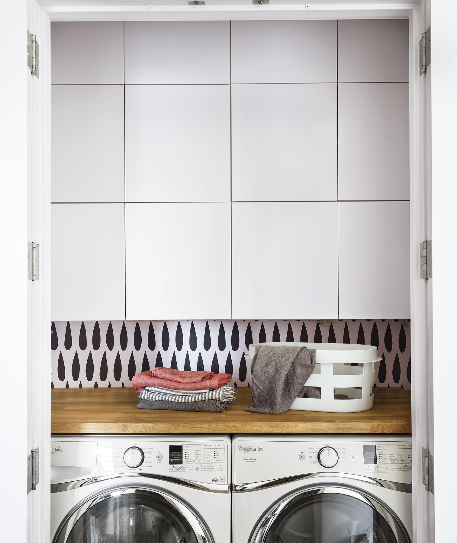Laundry closet with cabinets