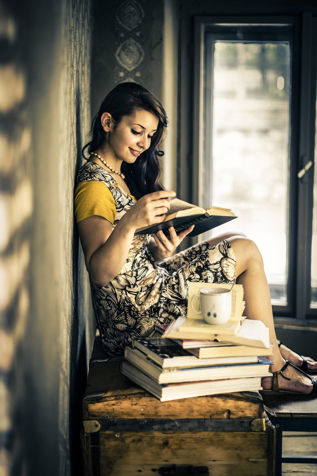 Woman Looking at Old Books