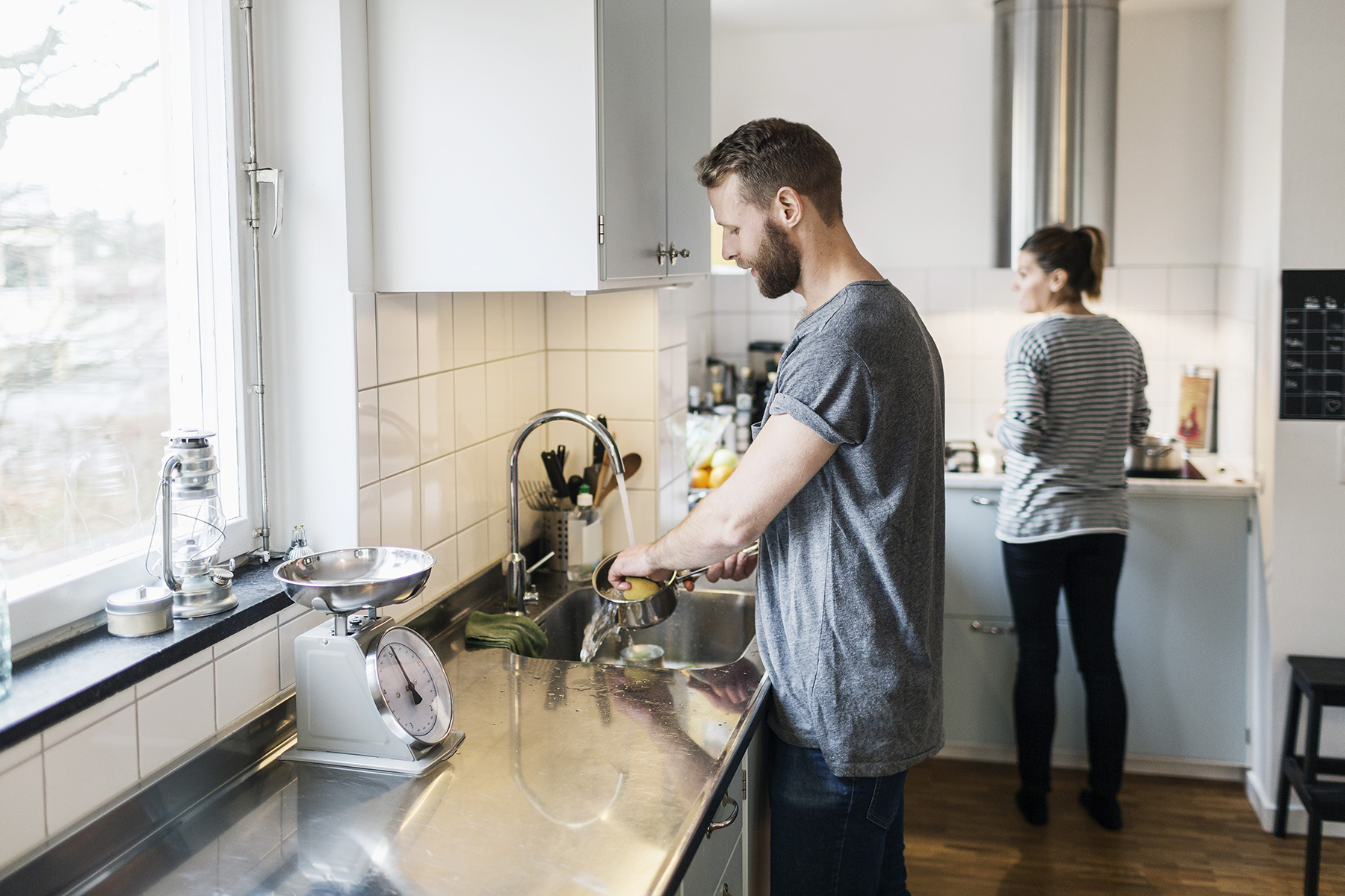 Man and woman in kitchen