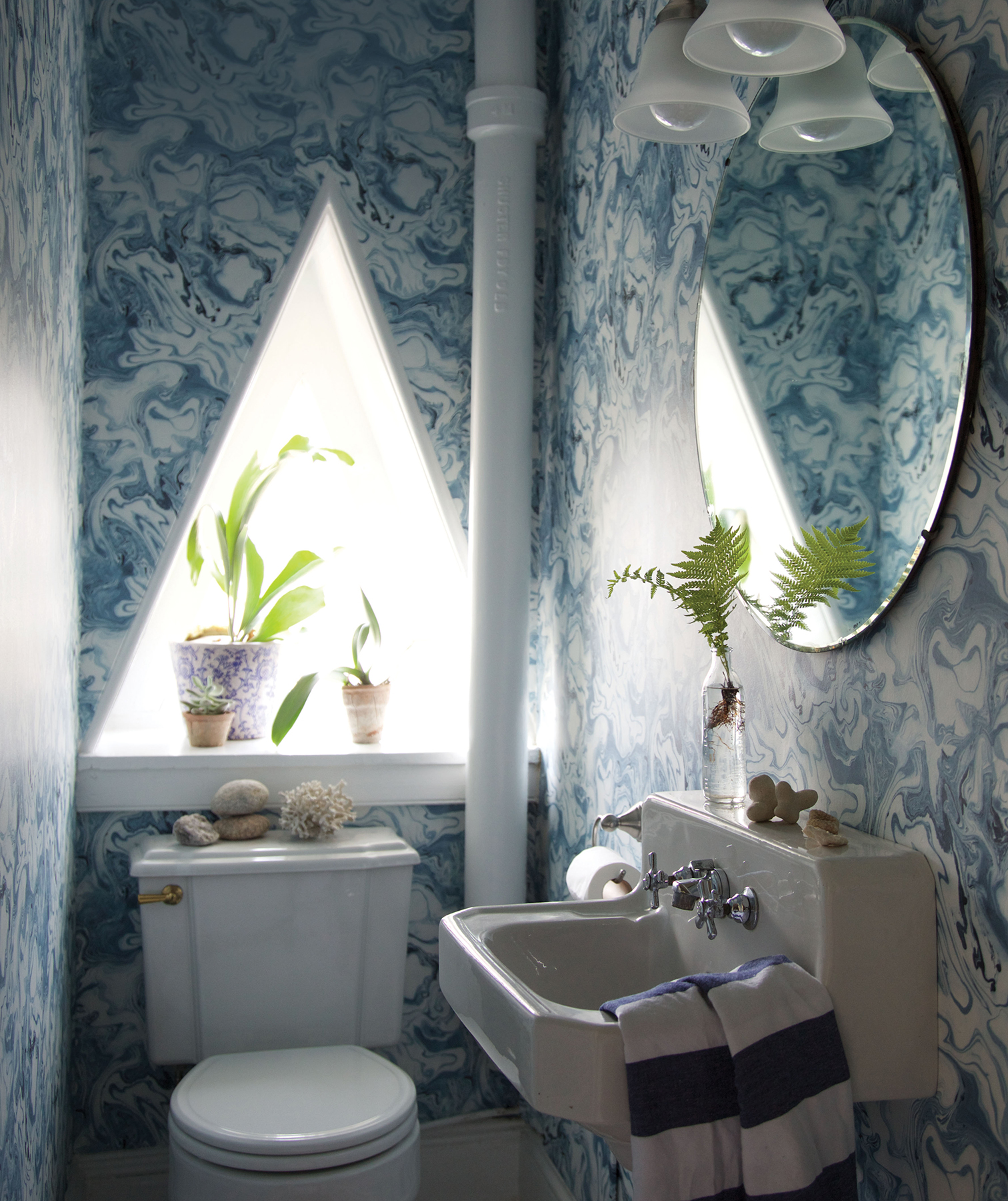 Bathroom with blue patterned walls
