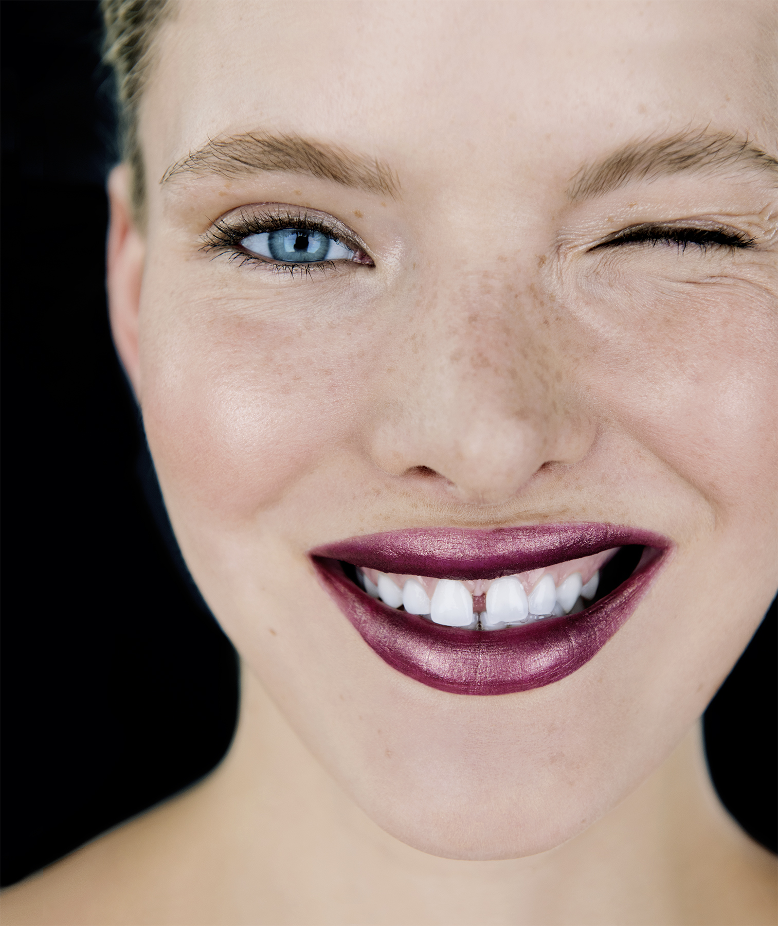 Model with pinkish plum metallic lipstick