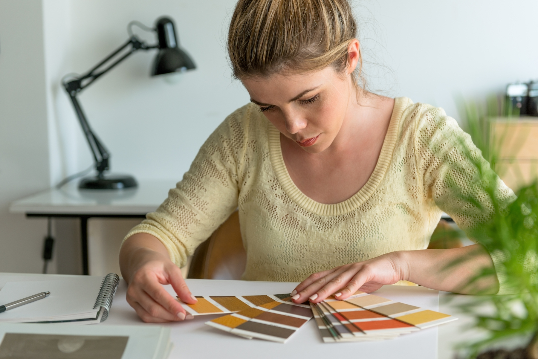 Woman Picking Paint Colors