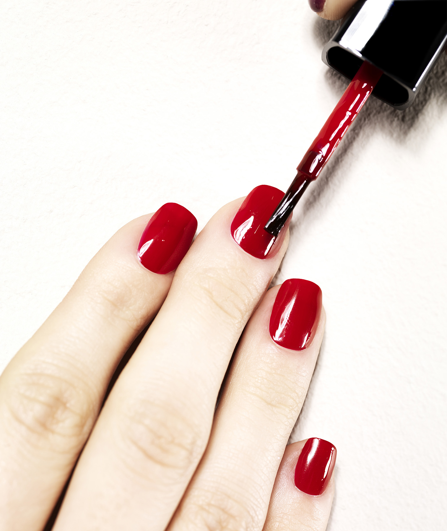 Painting nails with red polish