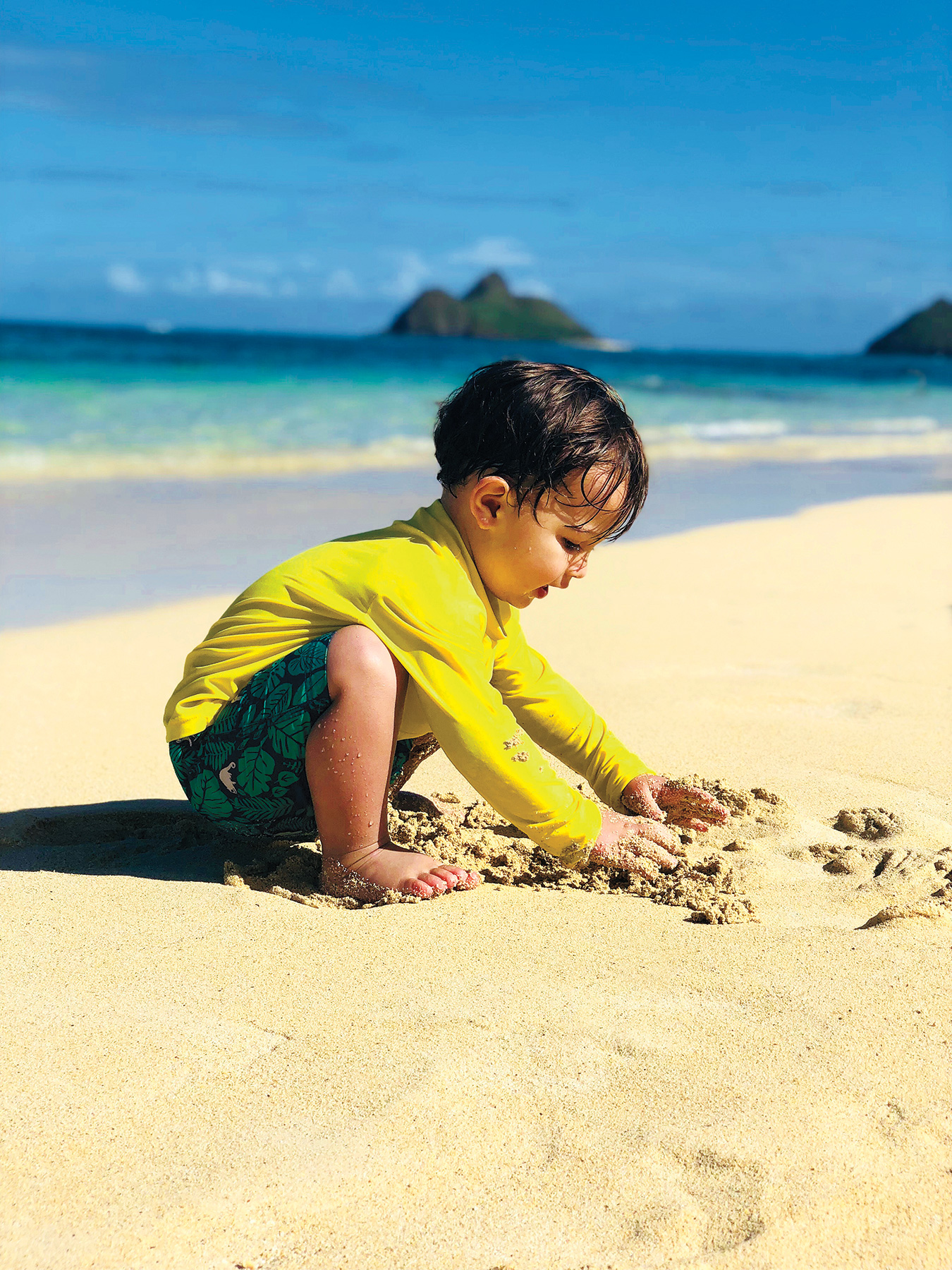 Boy playing in sand