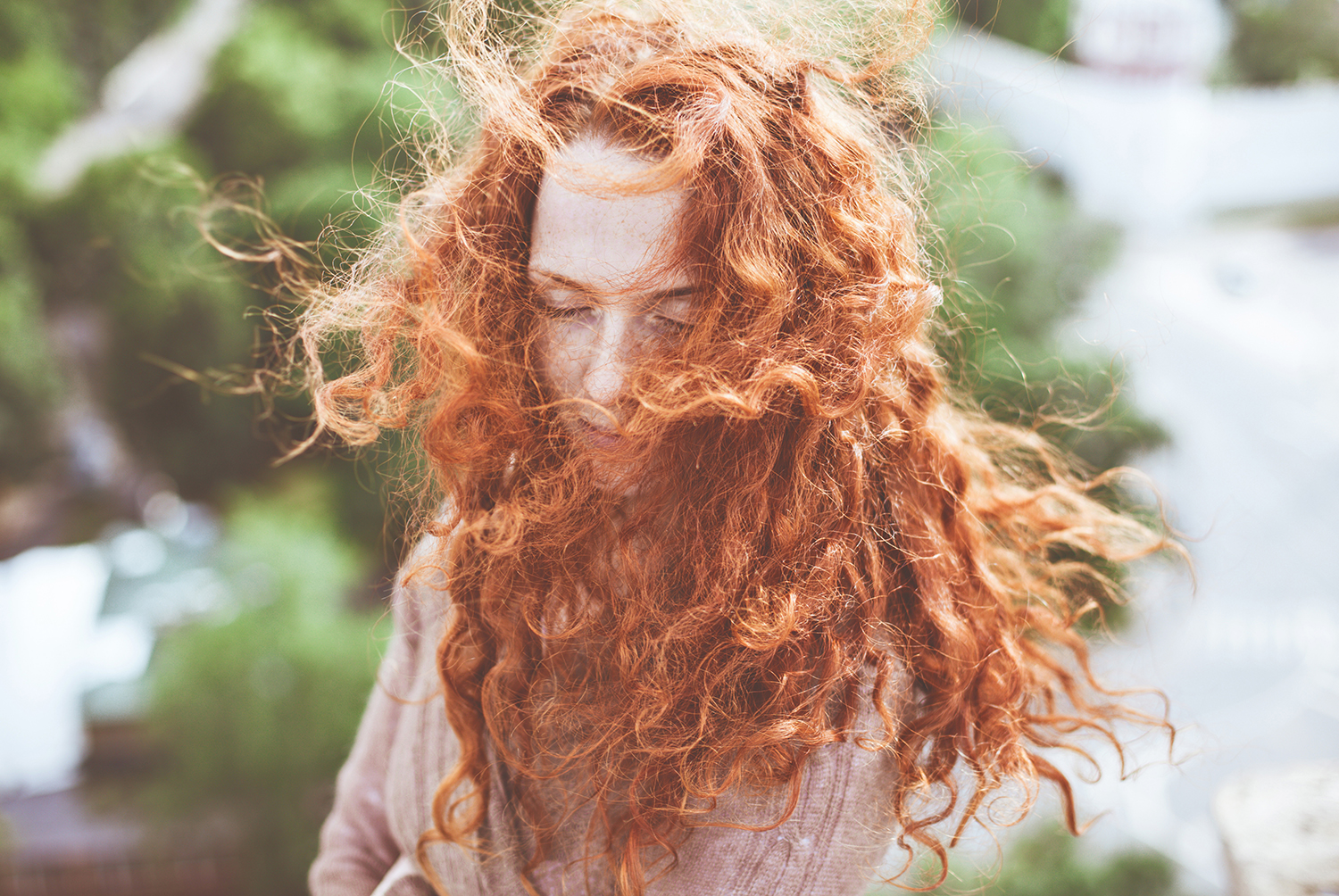 Red Haired Girl in Wind