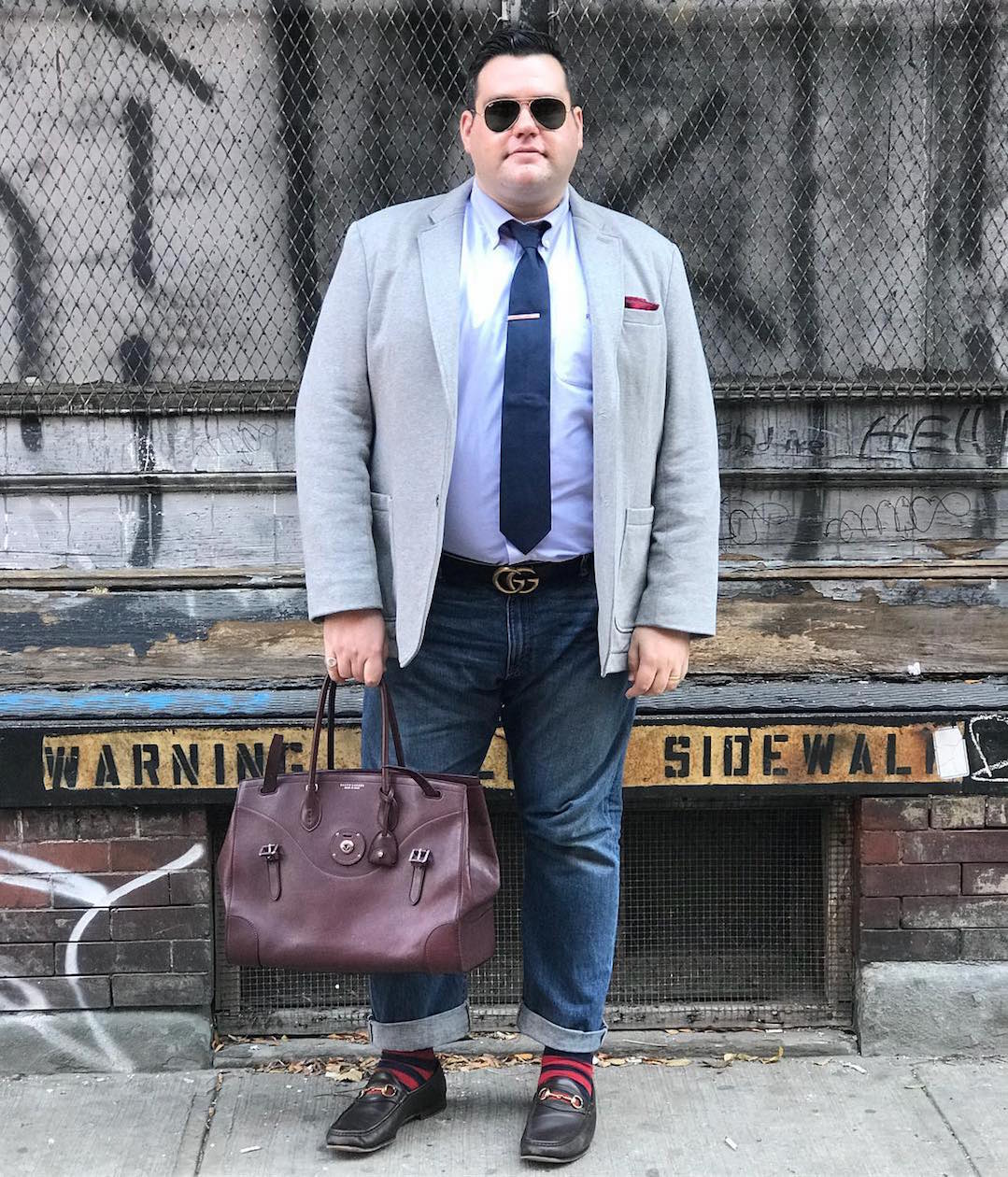 Ryan Dziadul with jacket, tie, bag, pocket square