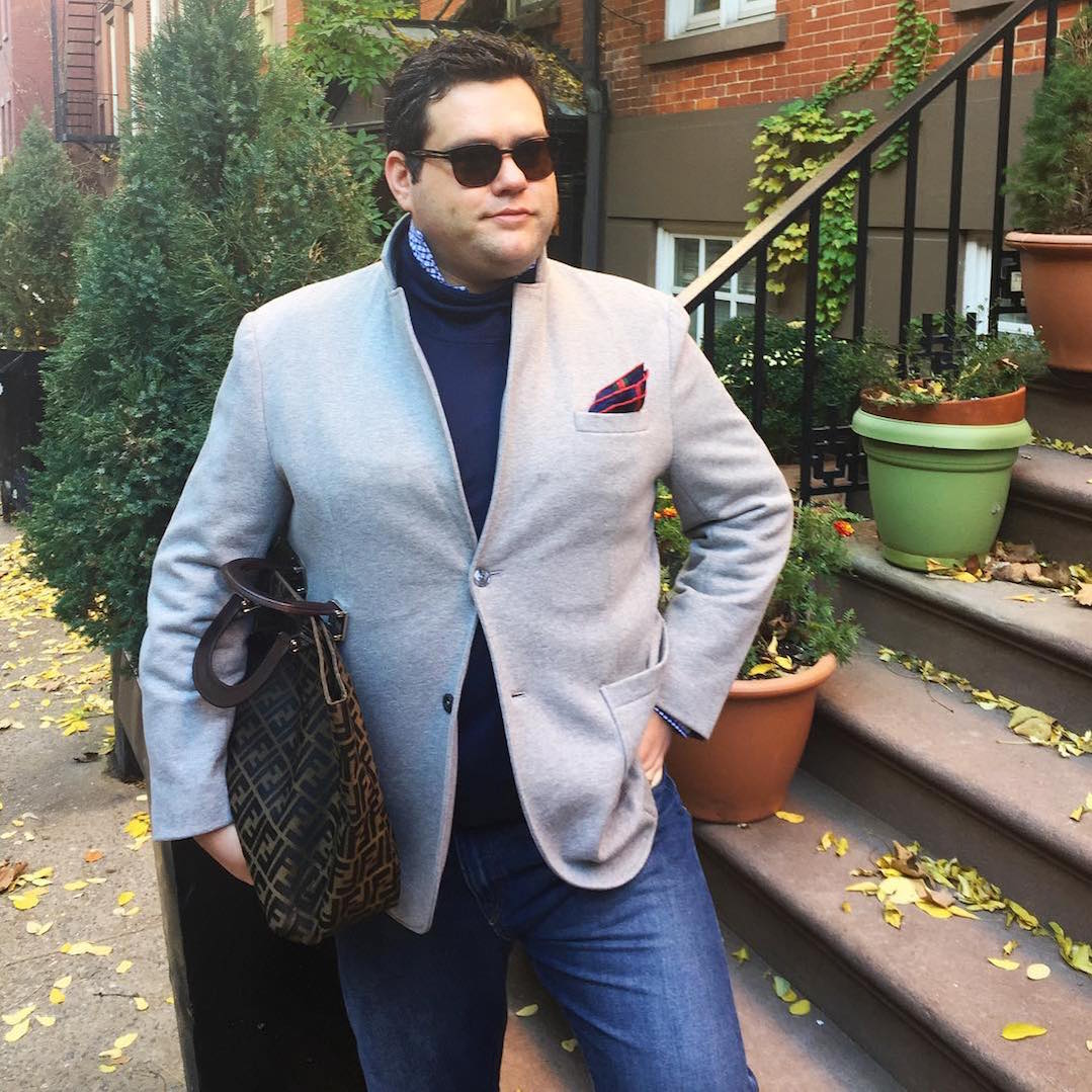 Ryan Dziadul in gray jacket, blue sweater, with pocket square