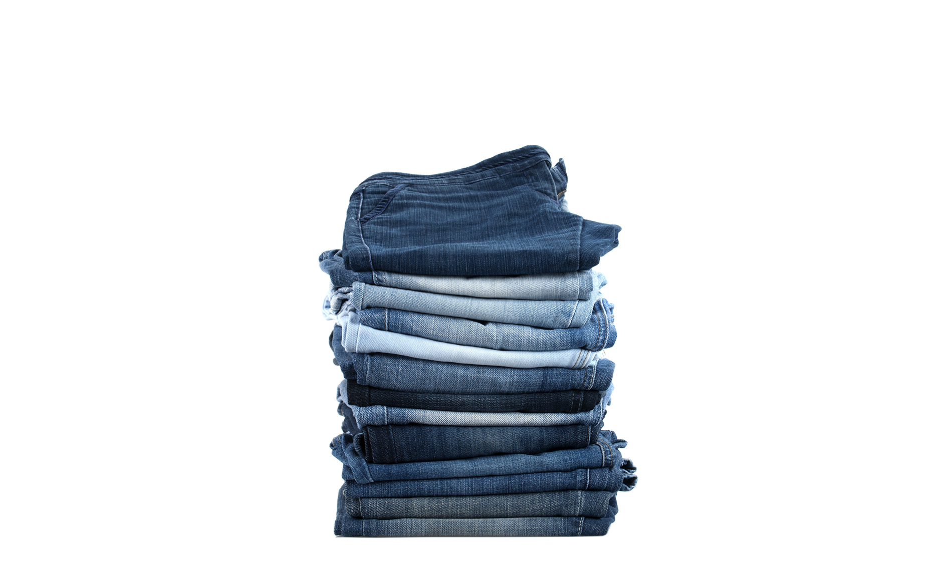 Pile of folded jeans, silo