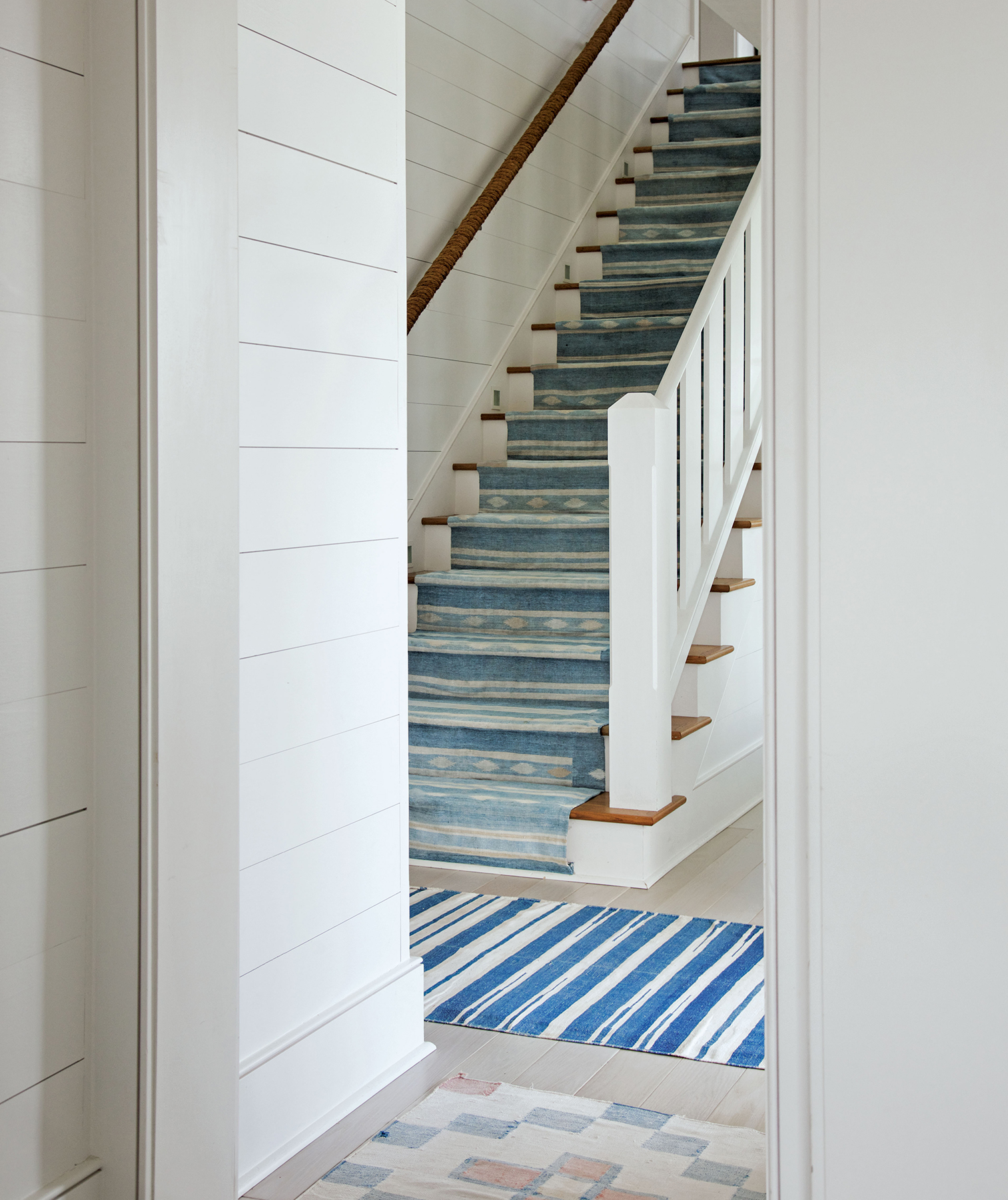 Stairs with blue patterned runner, rug