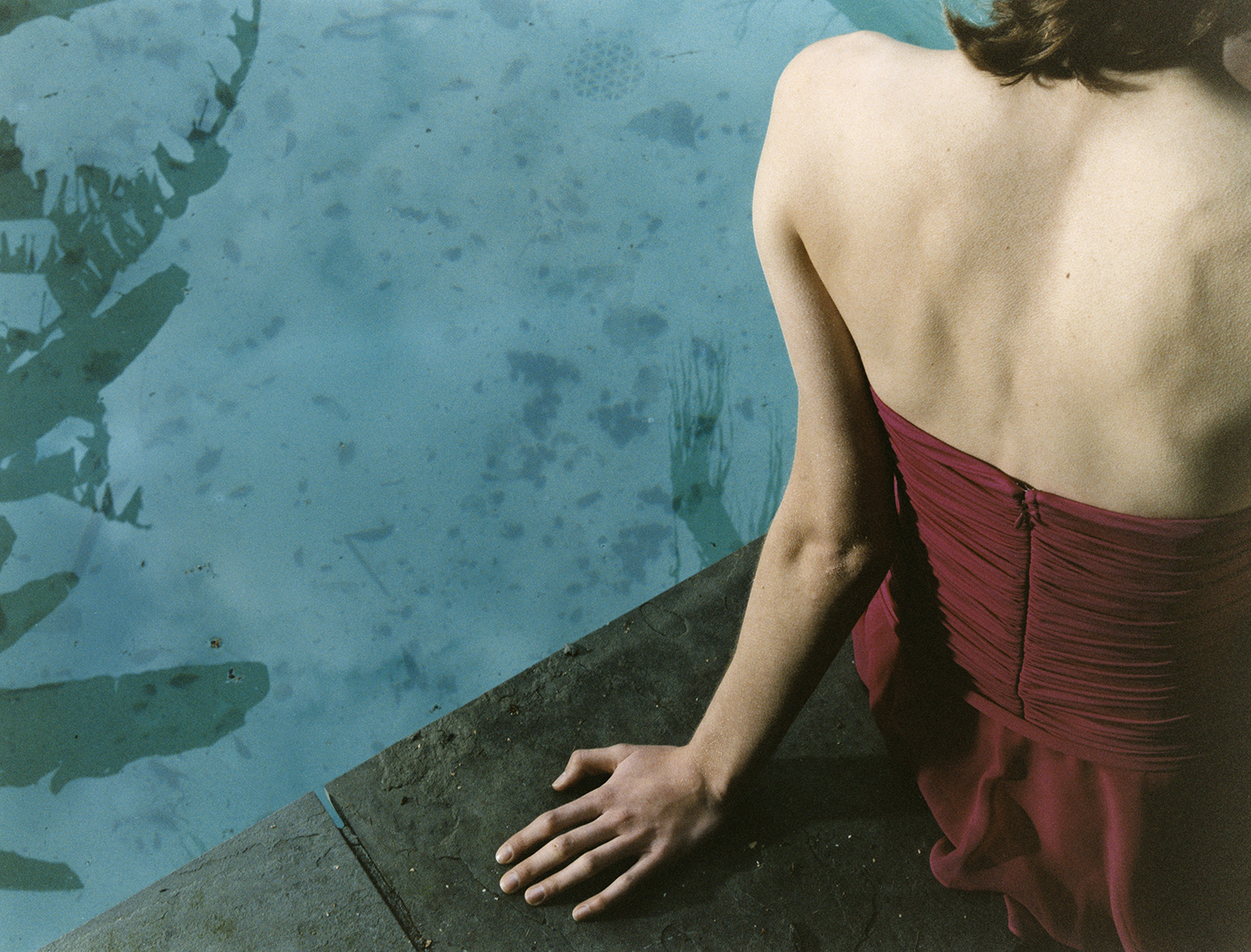 Woman in strapless dress poolside