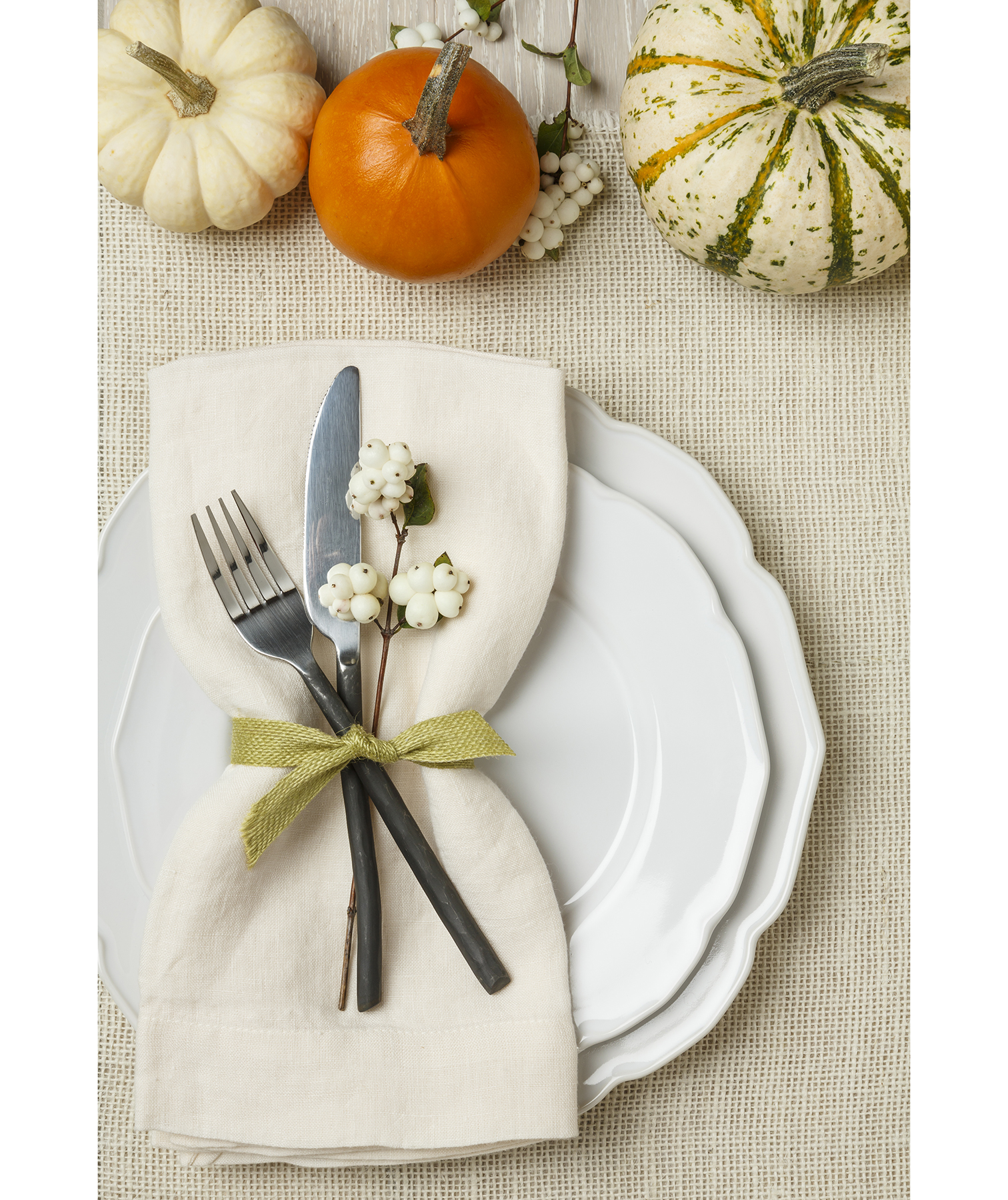 Thanksgiving place setting with mini pumpkins