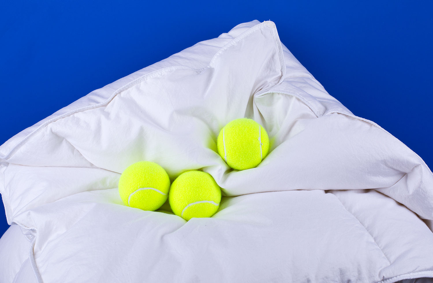 Tennis Ball as a Comforter Fluffer