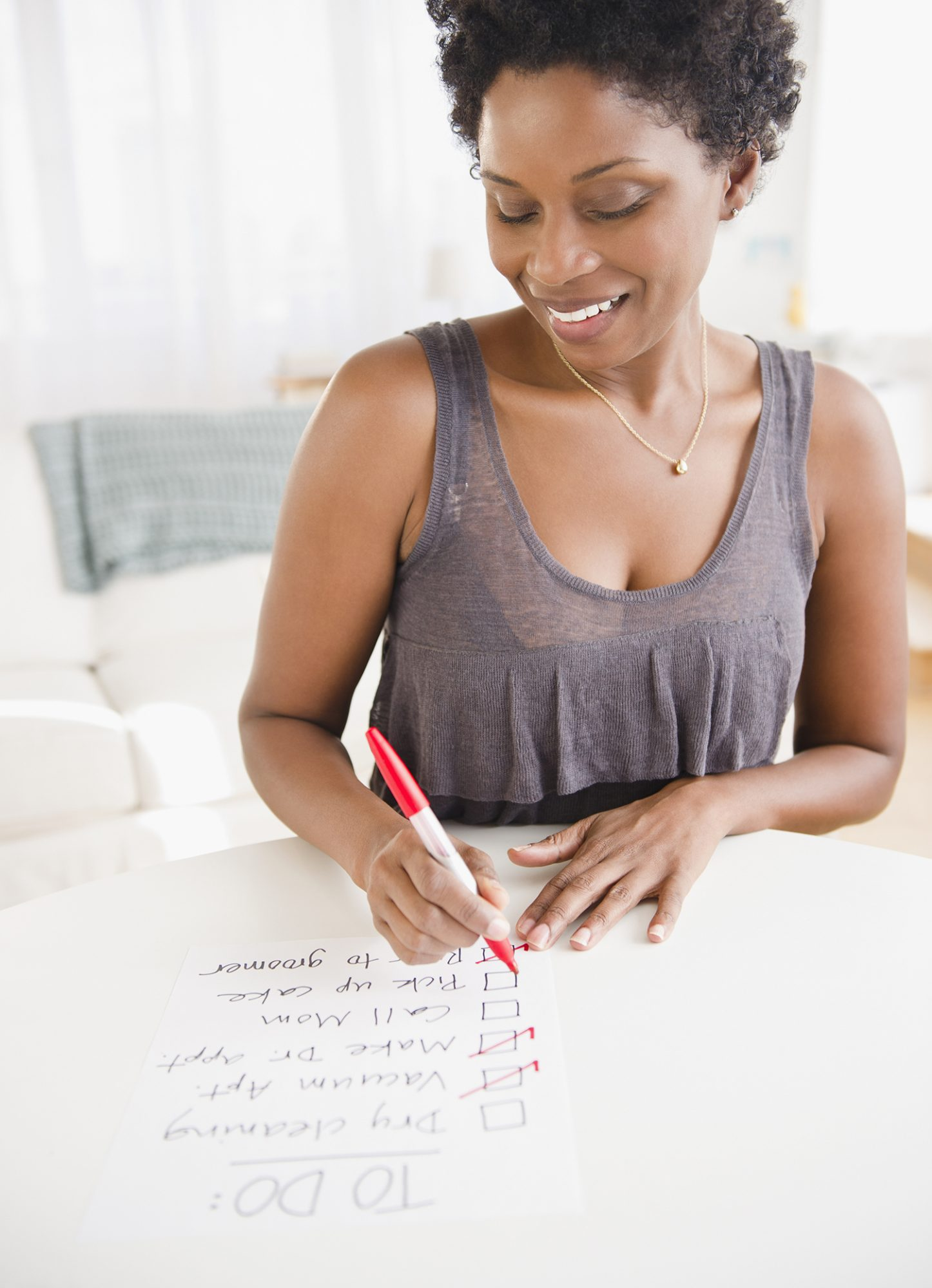 Woman Crossing Off Her to Do List
