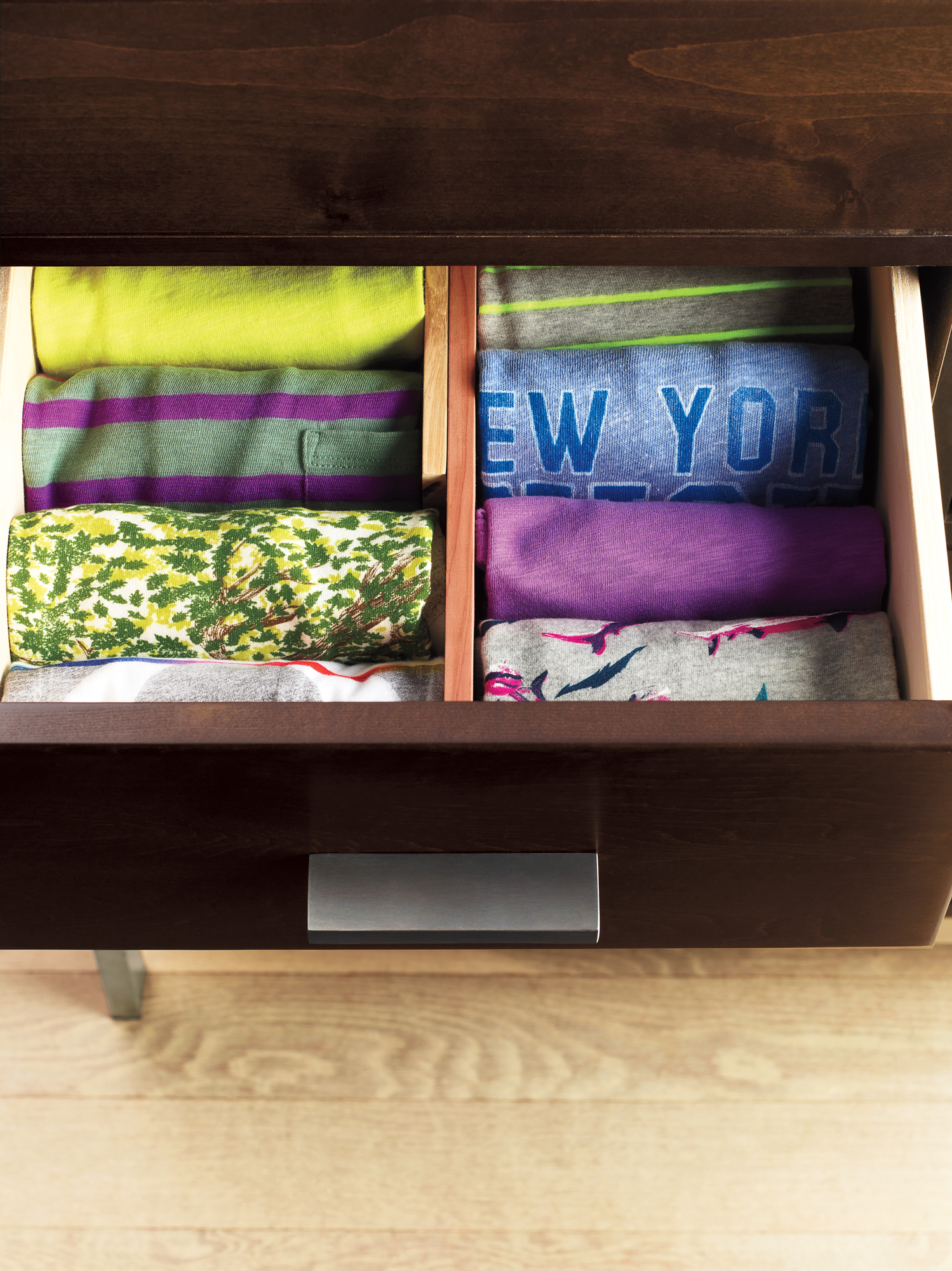 T-shirts rolled neatly into a drawer (NEW)