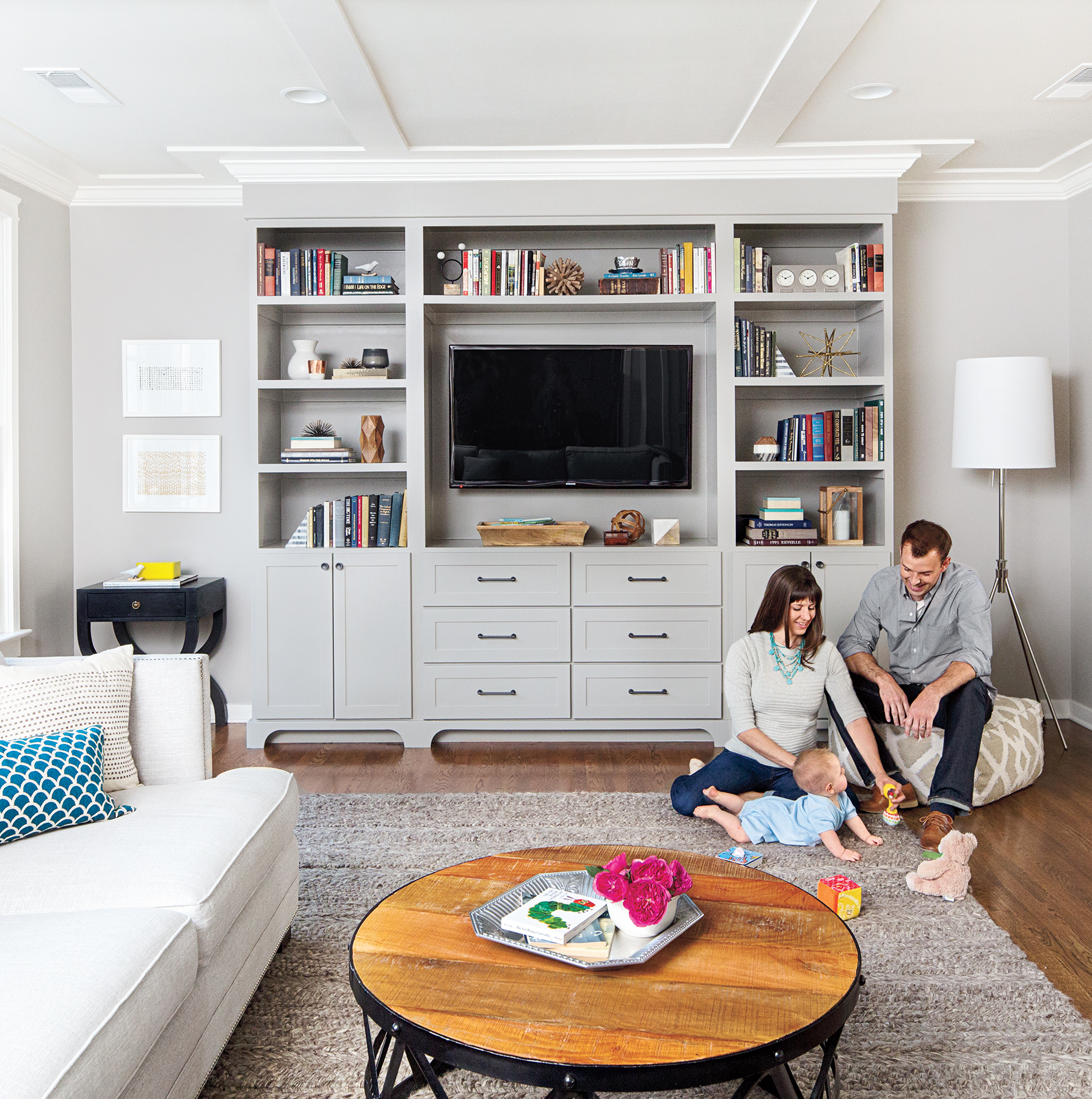 TV surrounded by bookshelves