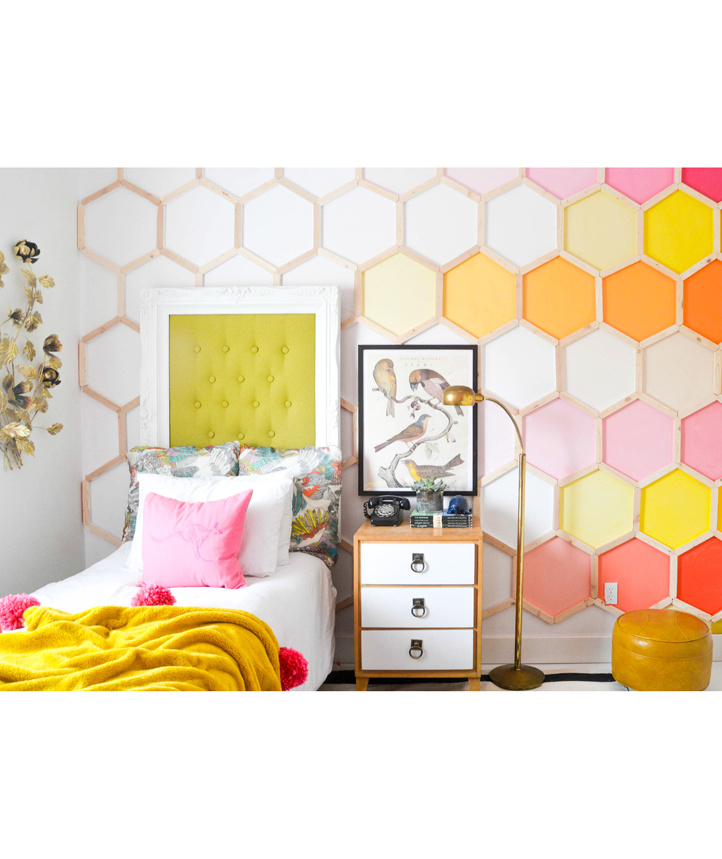 Girl's room with colorful hexagon pattern on wall