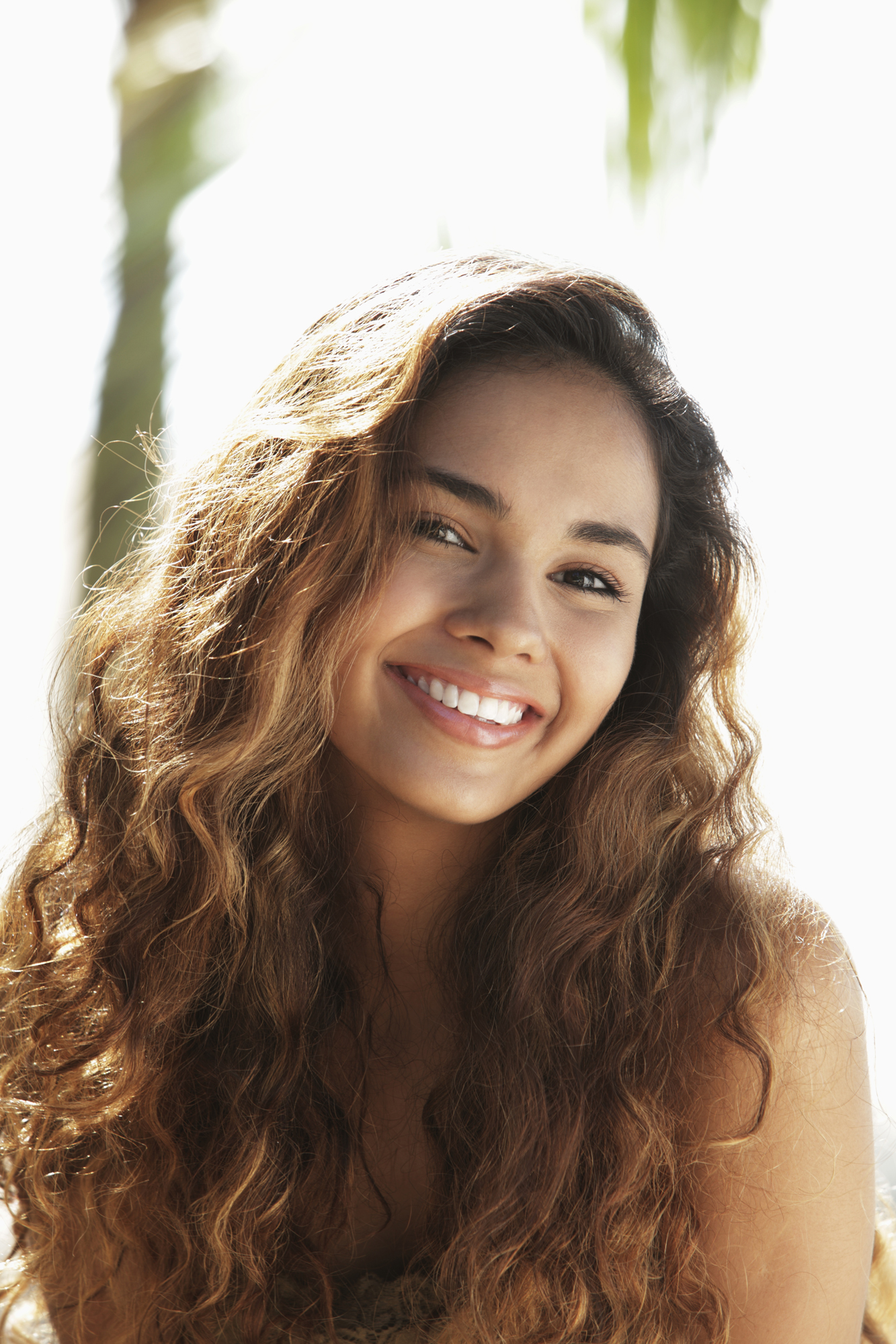 Smiling woman with wavy hair