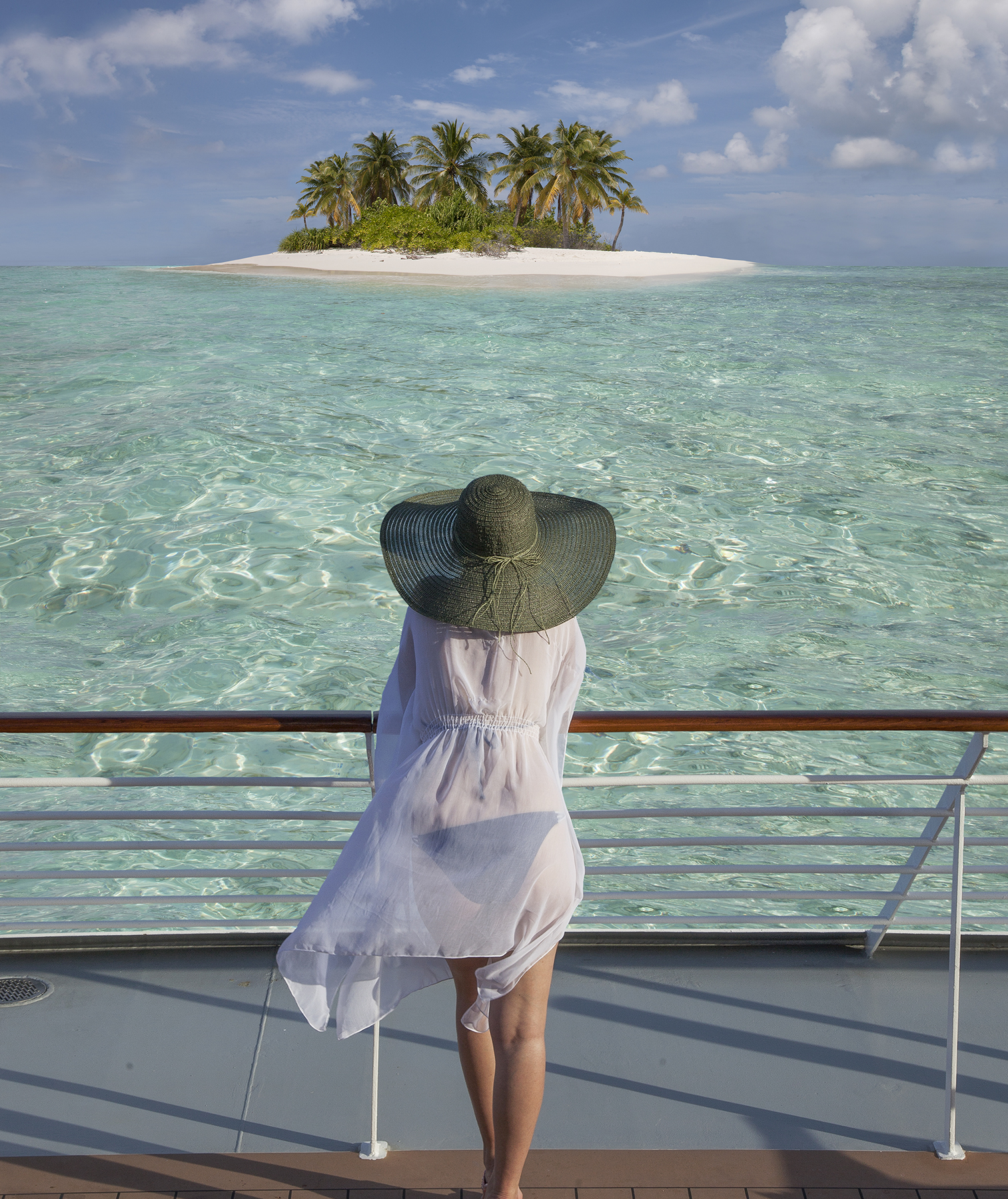 Woman looking at island from cruise ship