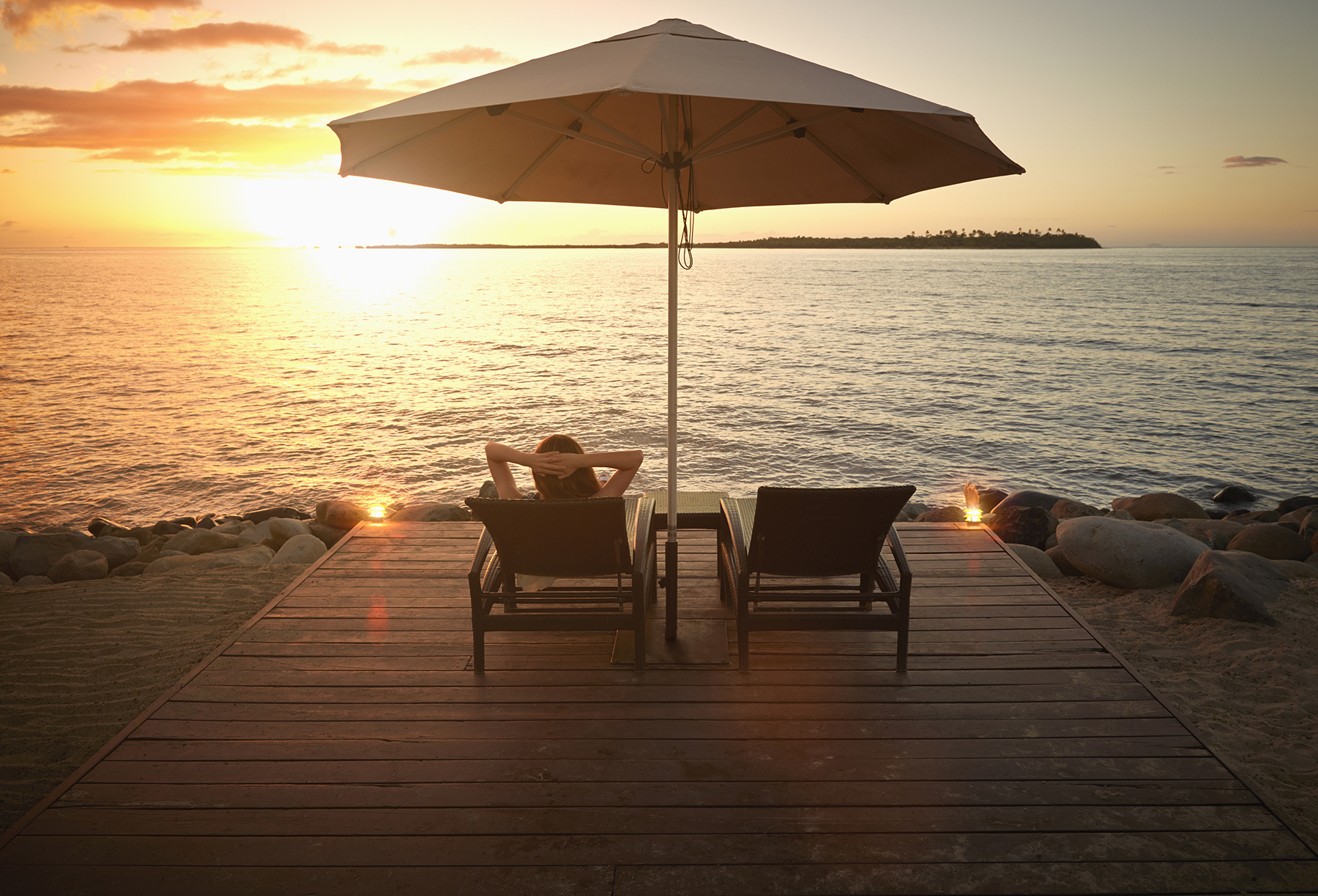 Woman relaxing alone at sunset