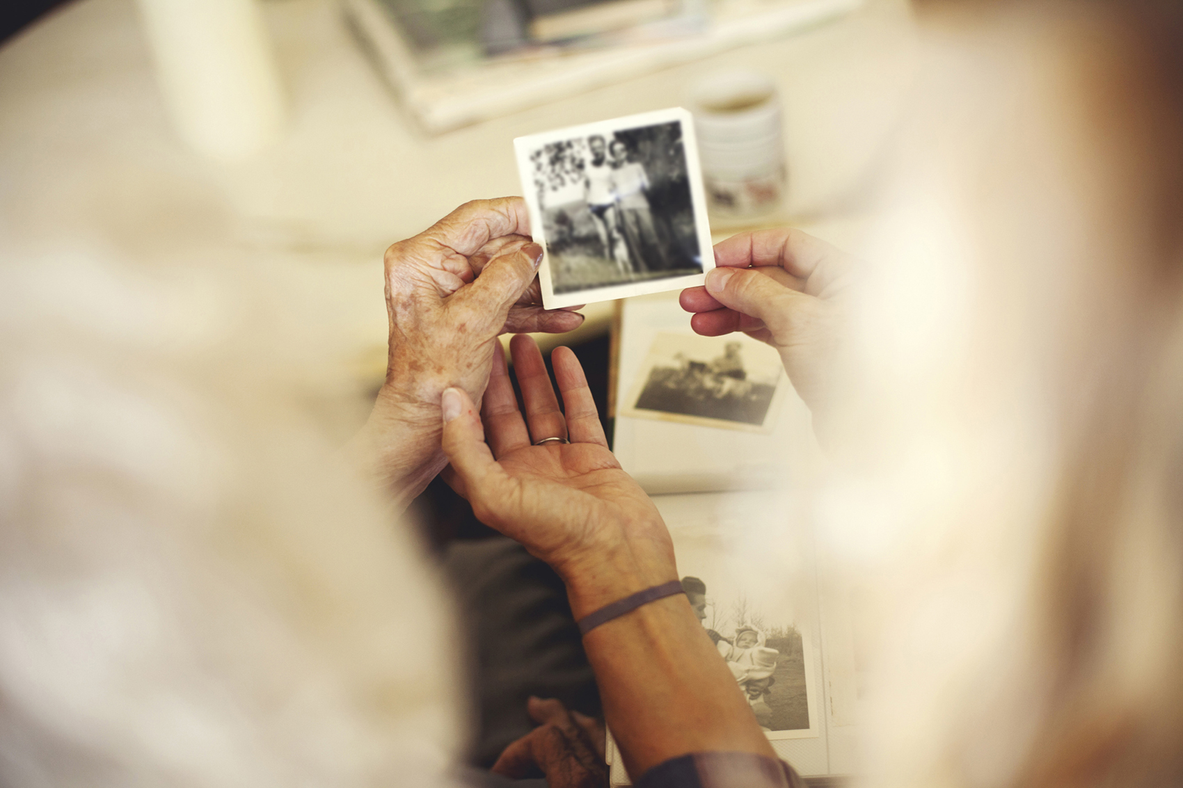 Hands holding old photographs