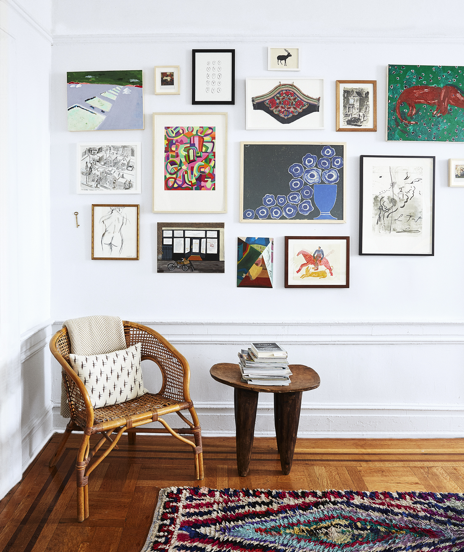 Bold gallery wall and patterned rug