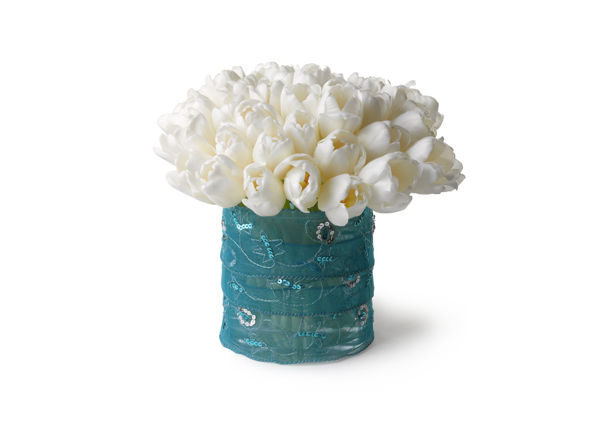 White tulips in ribbon-wrapped vase