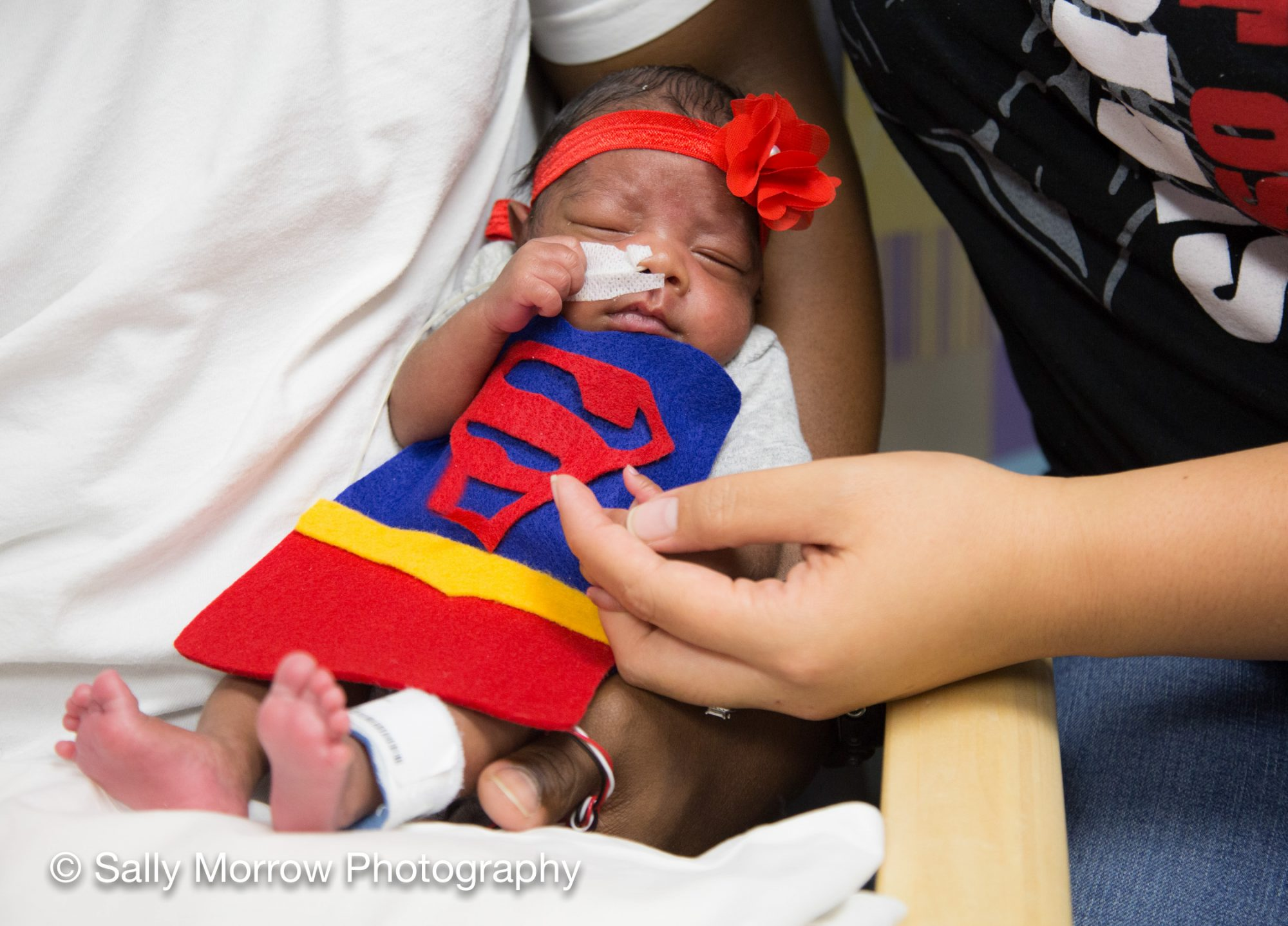 Infant at UAB Hospital in Supergirl Costume